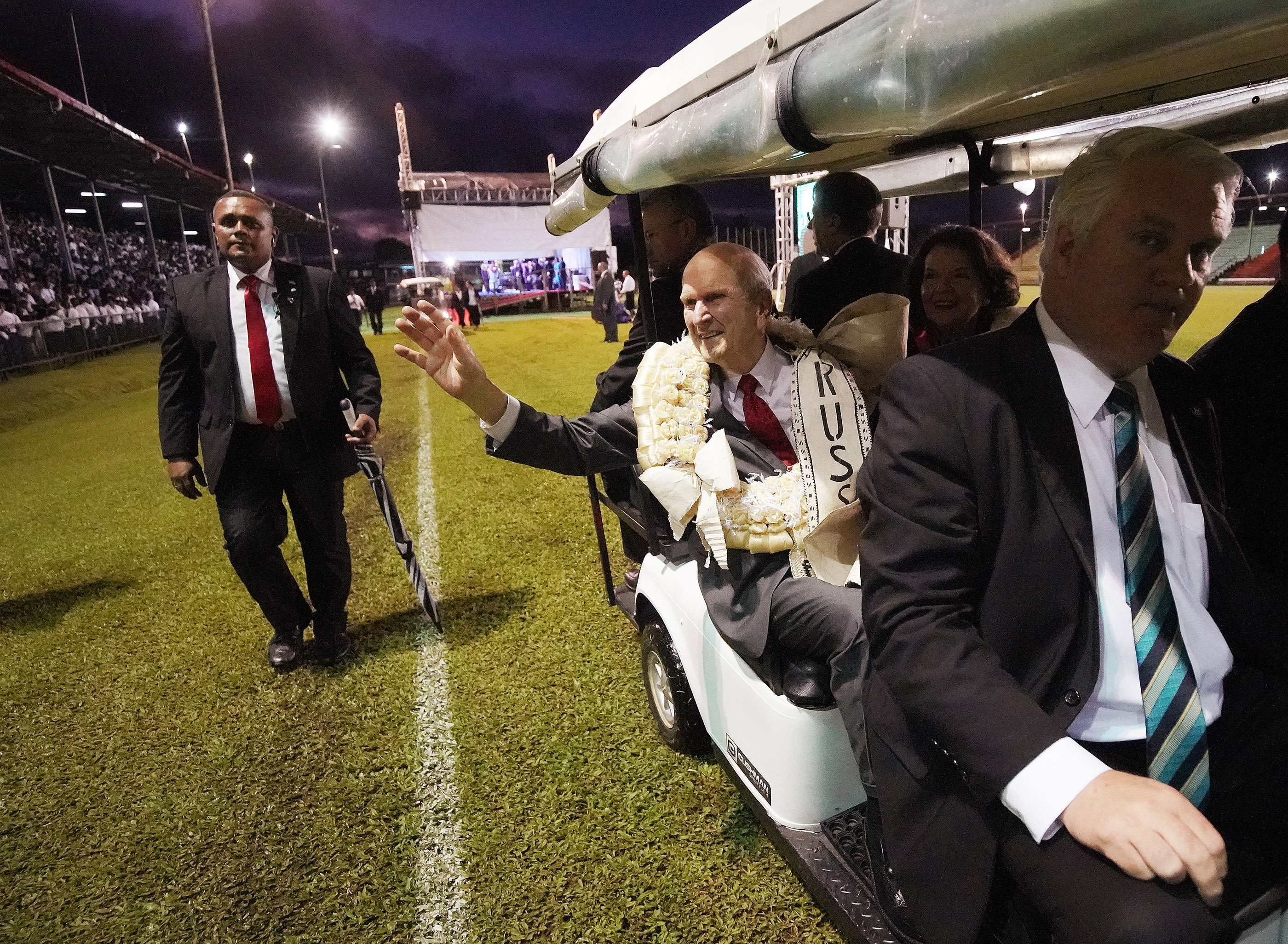 President Russell M. Nelson of The Church of Jesus Christ of Latter-day Saints waves to attendees after a devotional at Ratu Cakobau Park stadium in Nausori, Fiji, on May 22, 2019.