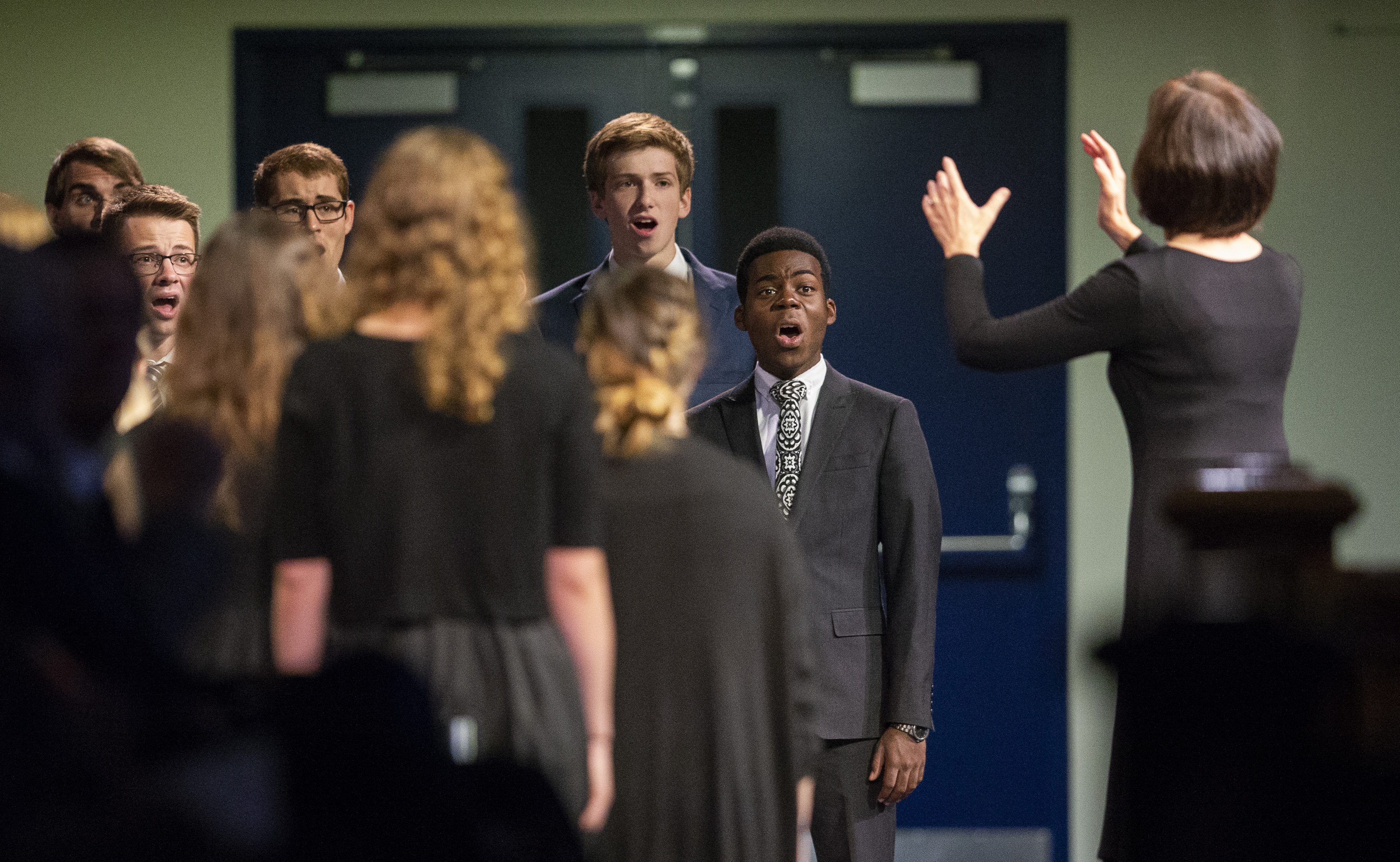 Choir members sing a special musical number prior to Elder Gerrit W. Gong of the Quorum of the Twelve Apostles speaking at a BYU campus devotional on Tuesday, Oct. 16, 2018.