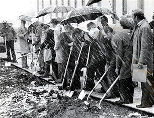 Amid swirling snow, officials and contractors break ground for new Genealogical (Family History) Library in May 1983.