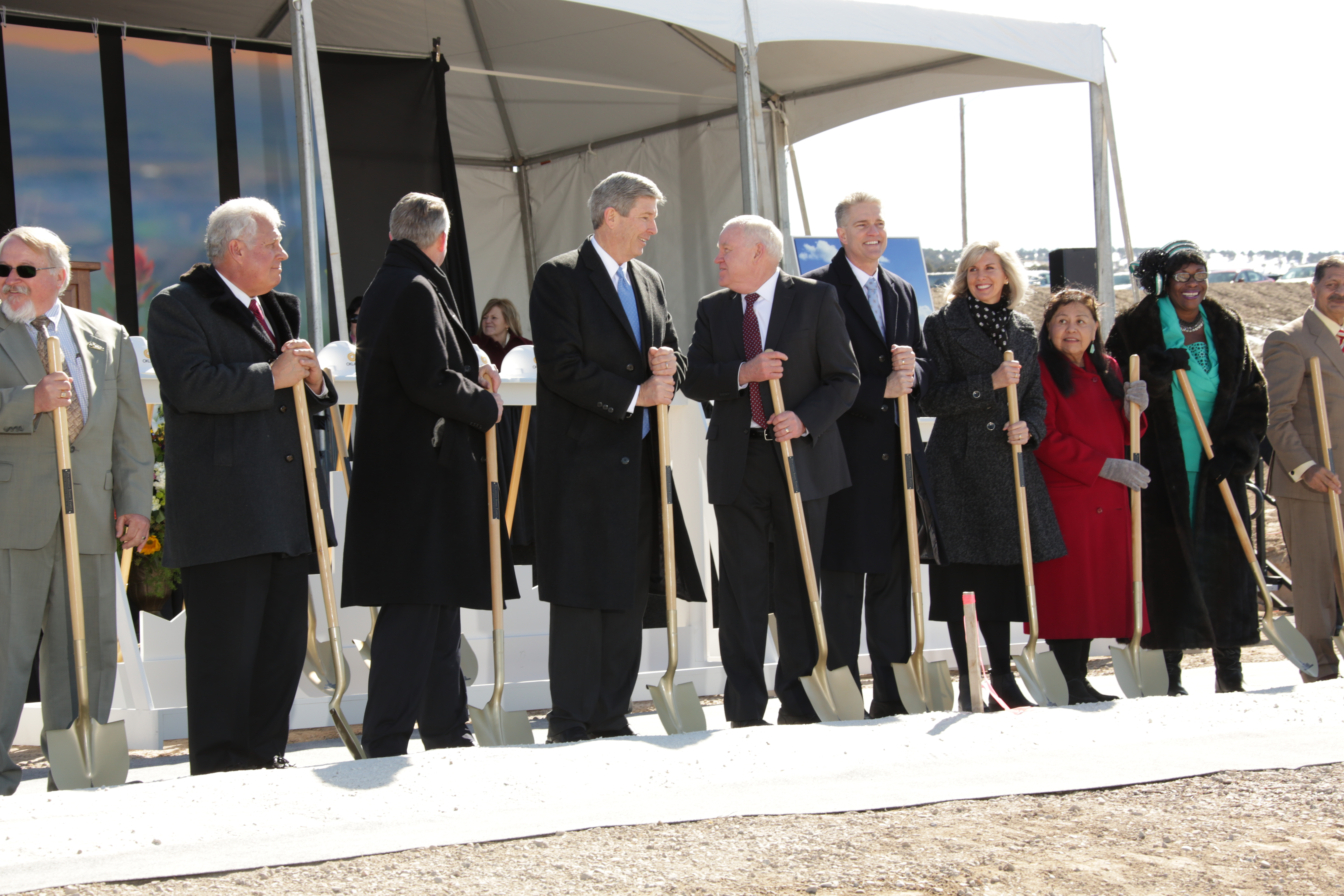 The Idaho Area Presidency — Elder Wilford W. Andersen, Elder S. Gifford Nielsen and Elder Brian K. Taylor — are joined at the ceremonial groundbreaking event for the future Pocatello Idaho Temple by representatives of the Pocatello-area religious community. Manning shovels were Jewish and Muslim leaders, along with clergy from several Christian congregations.,