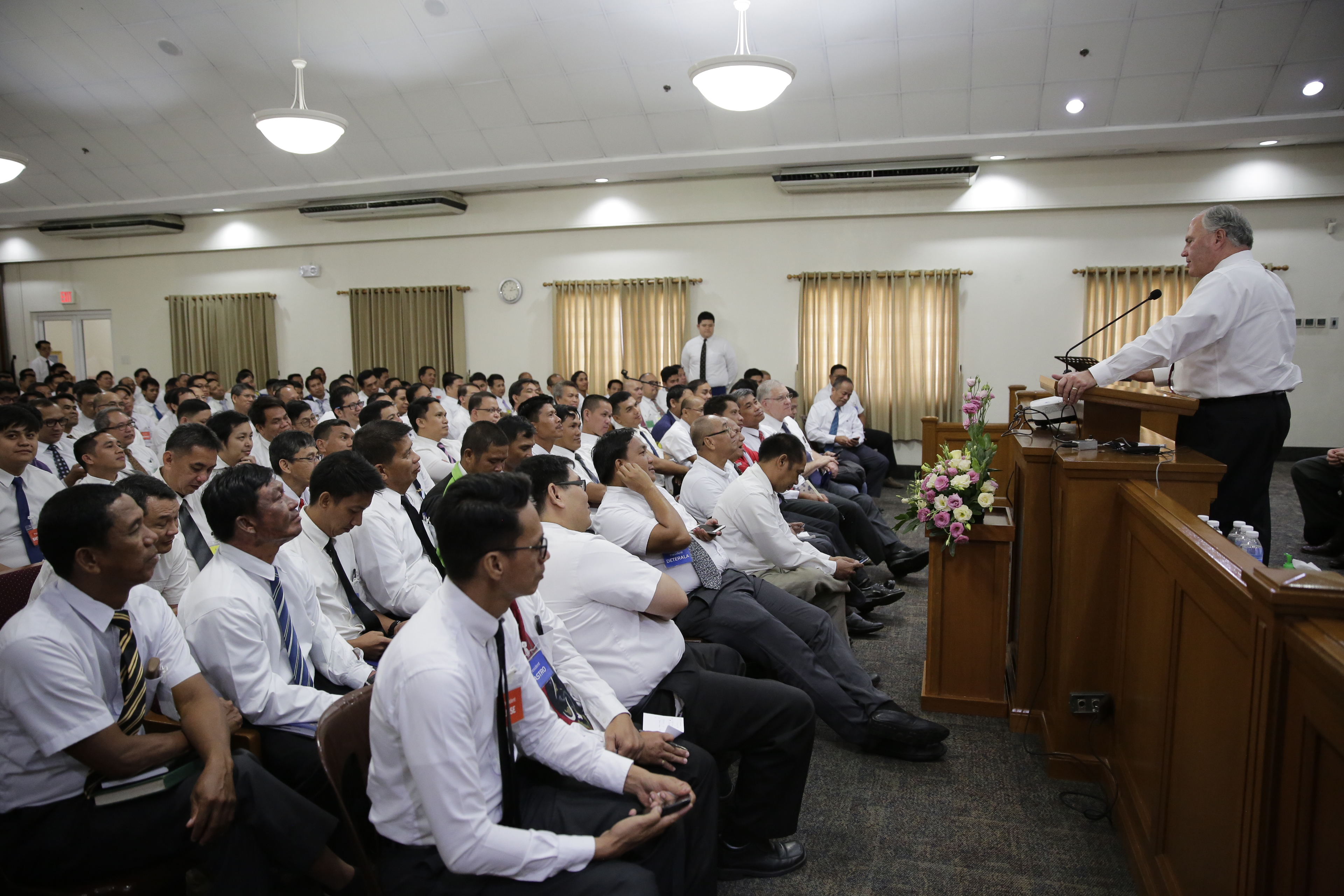 Elder Ronald A. Rasband visits with Filipino Latter-day Saint during his Feb. 13 through Feb. 26, 2018, trip to the Church's Philippines Area.