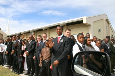 Members and missionaries line the meetinghouse sidewalks to say goodbye to the conference's visiting Church leaders.
