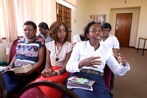 A woman makes a comment during a Sunday Relief Society class.