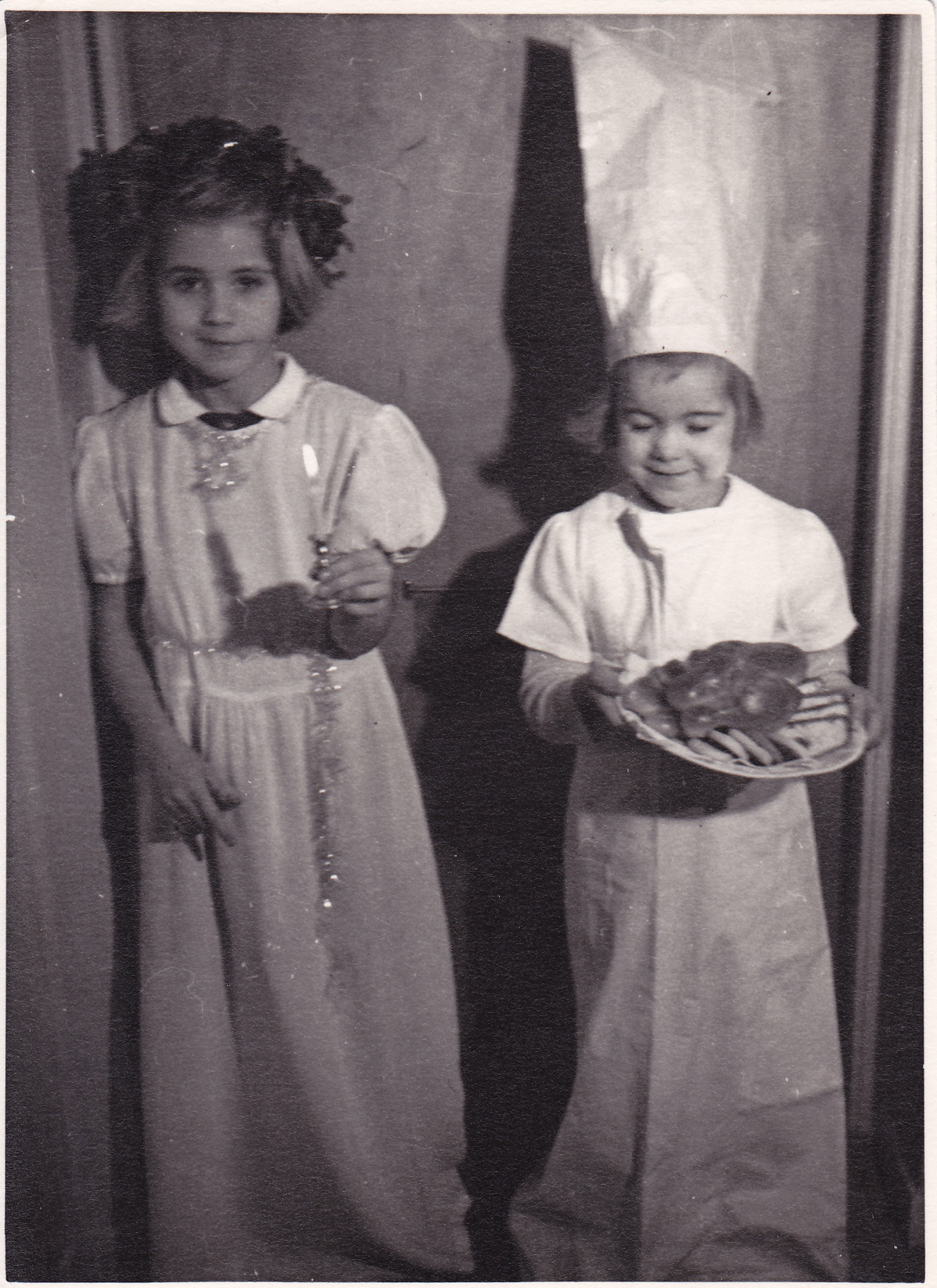 Lisbeth Pettersson, left, dressed up to celebrate the Swedish holiday Saint Lucia on December 13, 1949 with her younger sister Ann-Marie.