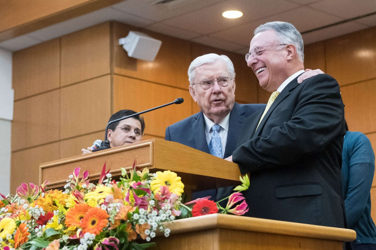 President M. Russell Balllard, with Elder Ulisses Soares, addresses members in Brazil. The leaders arrived in Sao Paulo, Brazil, on Aug. 24, 2018.