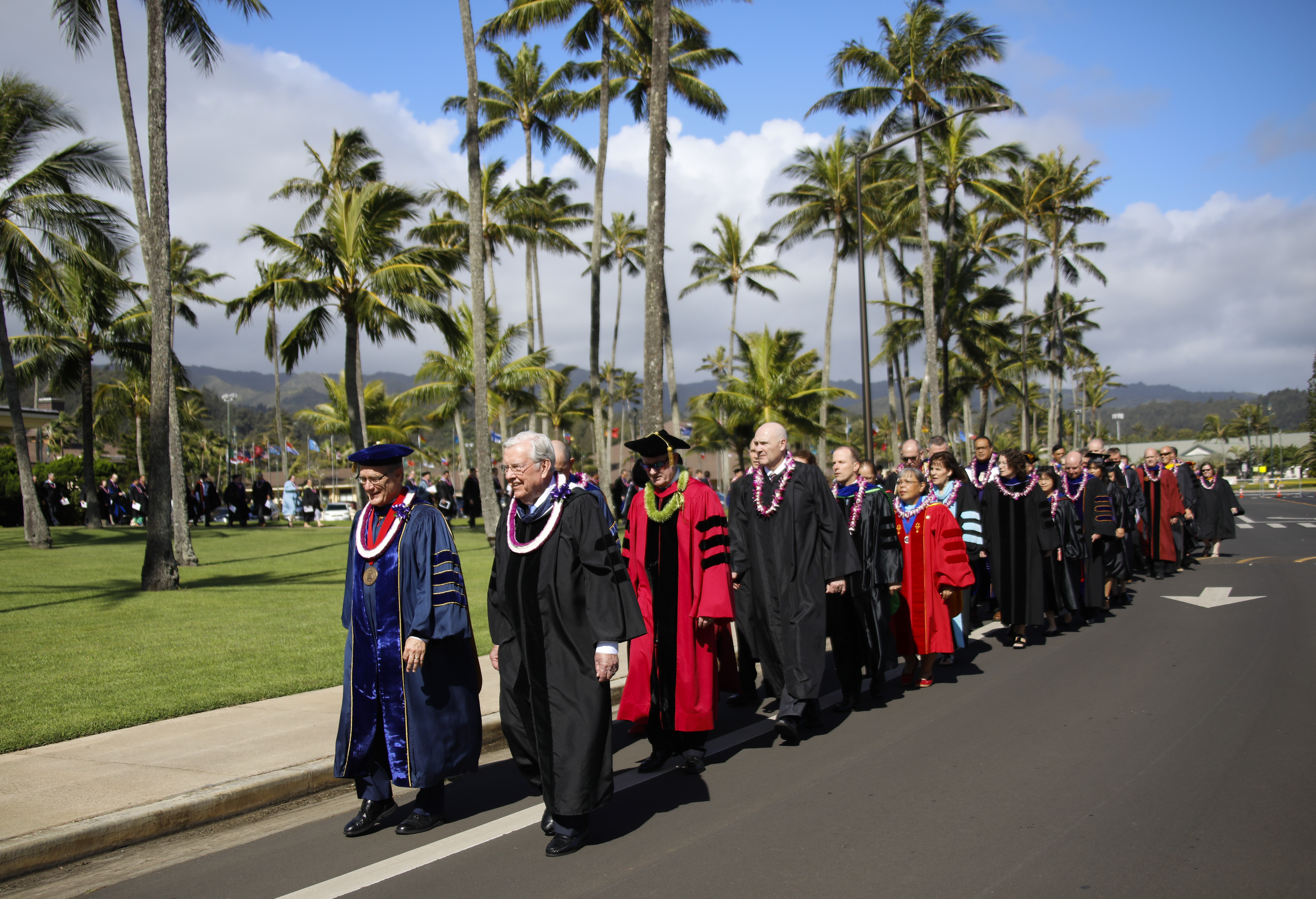 President M. Russell Ballard leads the procession of faculty prior to the BYU-Hawaii Winter Semester Commencement ceremony on April 20, 2019.