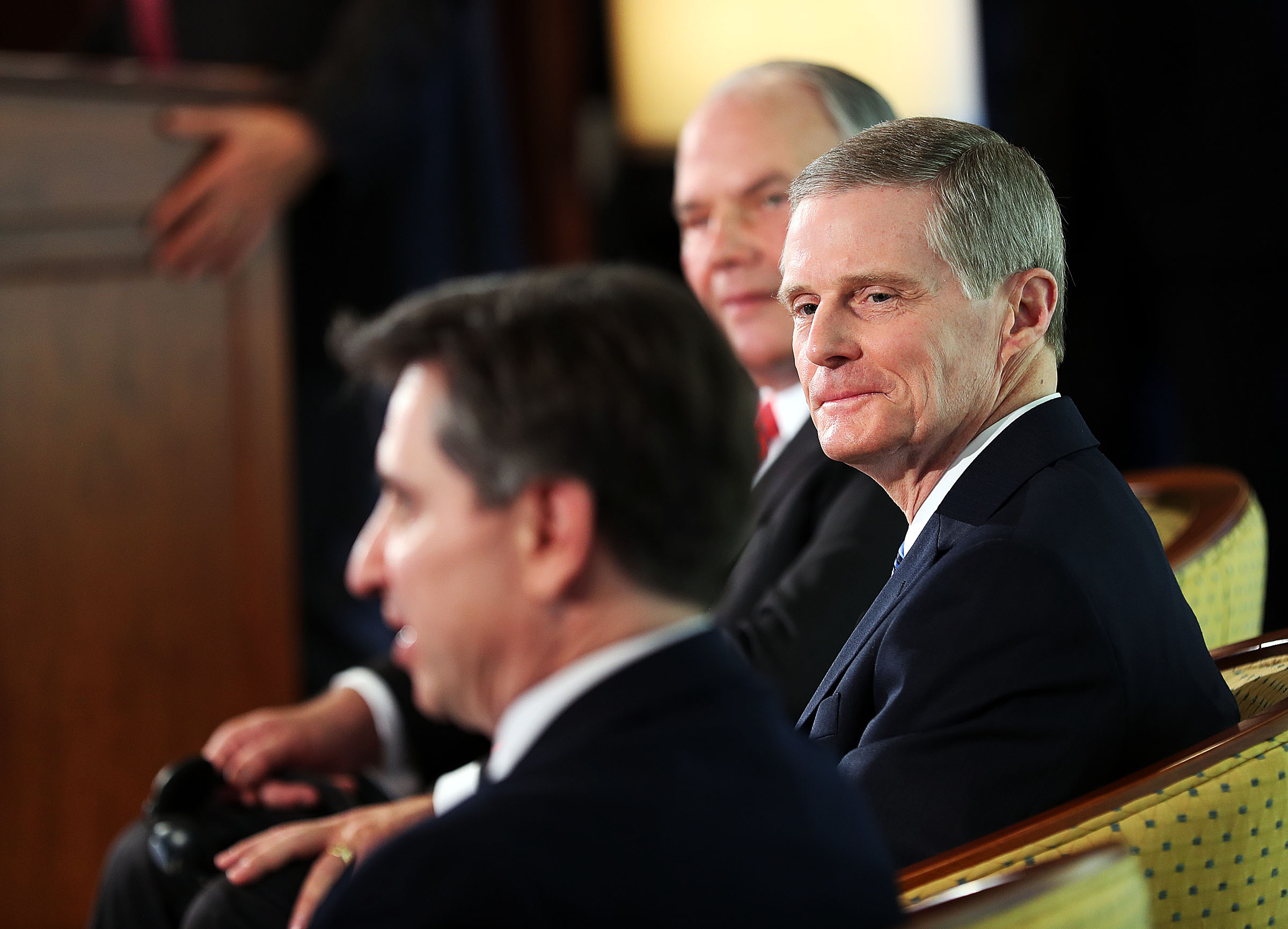 Elder Ronald A. Rasband, back, and Elder David A. Bednar of the Quorum of the Twelve Apostles listen as Elder Massimo De Feom, General Authority Seventy, answers a question during a press conference in the Rome Temple Visitors' Center of The Church of Jesus Christ of Latter-day Saints on Monday, Jan. 14, 2019.