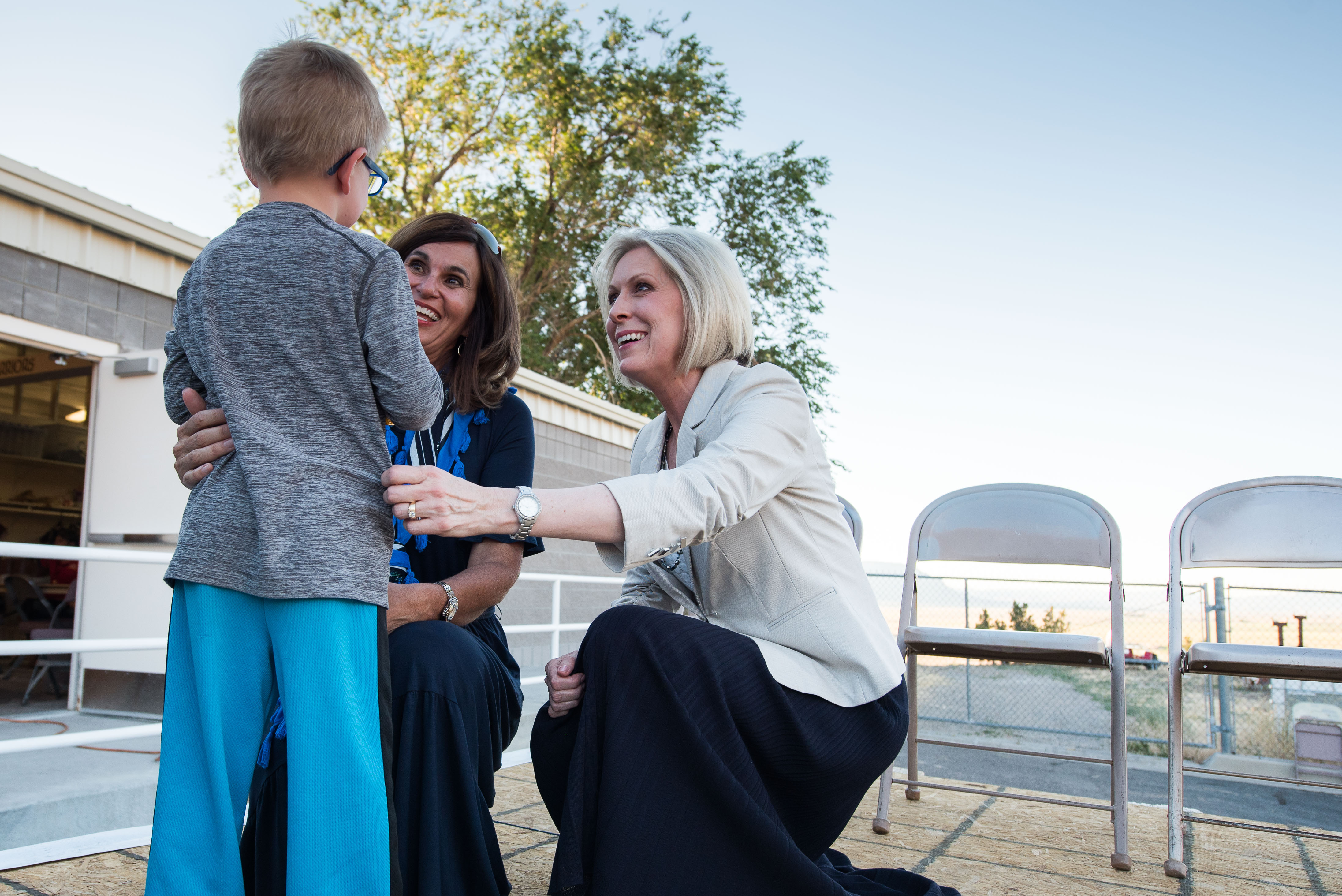 Sister Joy D. Jones, Primary general president, and Sister Lisa L. Harkness, first counselor in the Primary presidency, greet children performing in the Mormon Miracle Pageant in Manti, Utah on June 20.