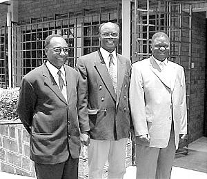 The new presidency of the Nairobi Kenya Stake, Pres. Joseph W. Sitati and his counselors, Daniel Muthiani and Hesborn O. Usi, pause on historic day of country's first stake.