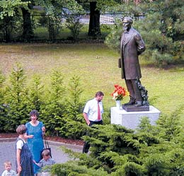 Larger-than-life bronze statue of Karl G. Maeser placed near Dresden Stake Center.