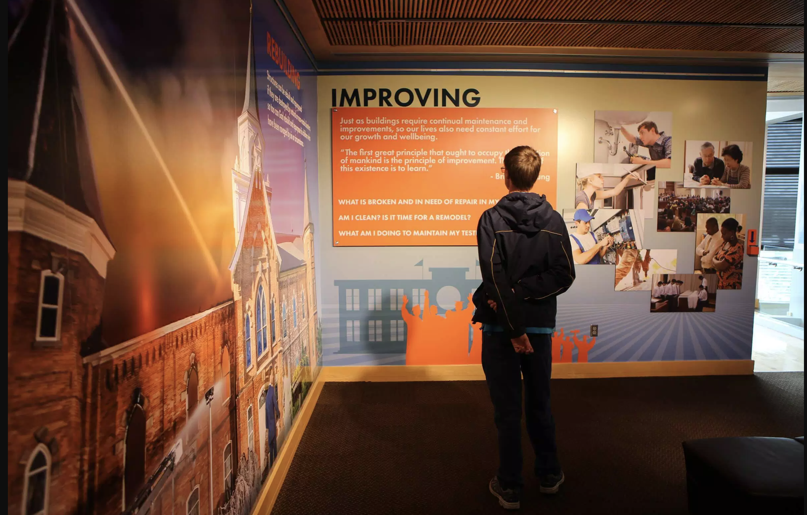 """A visitor to the Education in Zion Gallery at Brigham Young University takes in the """"Constructing a Soul"""" exhibition that will be on display until the summer of 2022."""