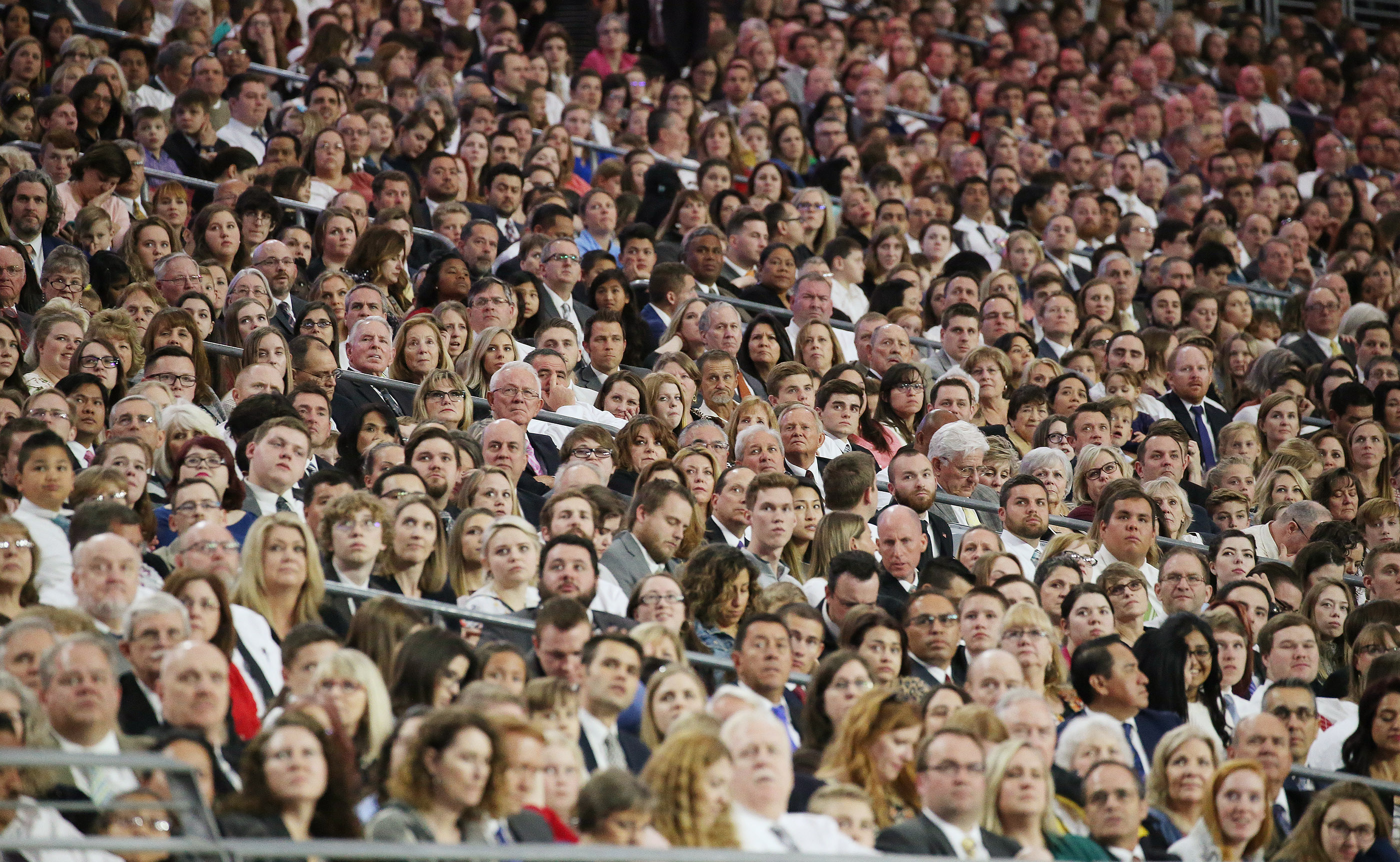 Attendees listen as President Russell M. Nelson of The Church of Jesus Christ of Latter-day Saints speaks during a devotional at the State Farm Stadium in Phoenix on Sunday, Feb. 10, 2019.