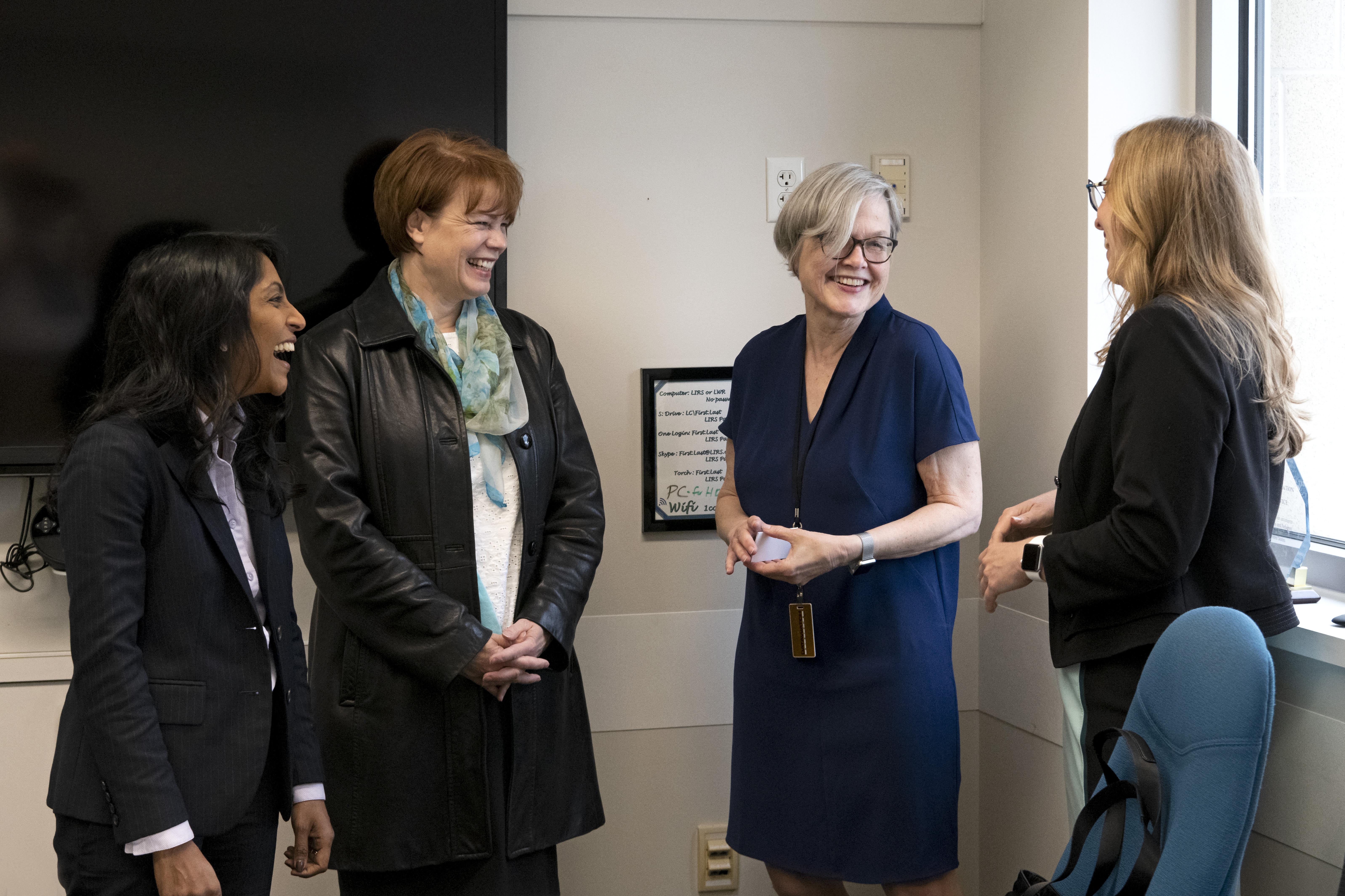 Krish O'Mara Vignarajah, left, president and CEO of Lutheran Immigration and Refugee Service (LIRS), and Kay Bellor, second from right, vice president for LIRS Programs, welcome Sister Sharon Eubank, second on the left, president of Latter-day Saint Charities, and Elissa McConkie, right, manager of Humanitarian Major Initiatives for the Church. Latter-day Saint Charities provided grants to several East Coast charities on May 14 and 15, 2019.