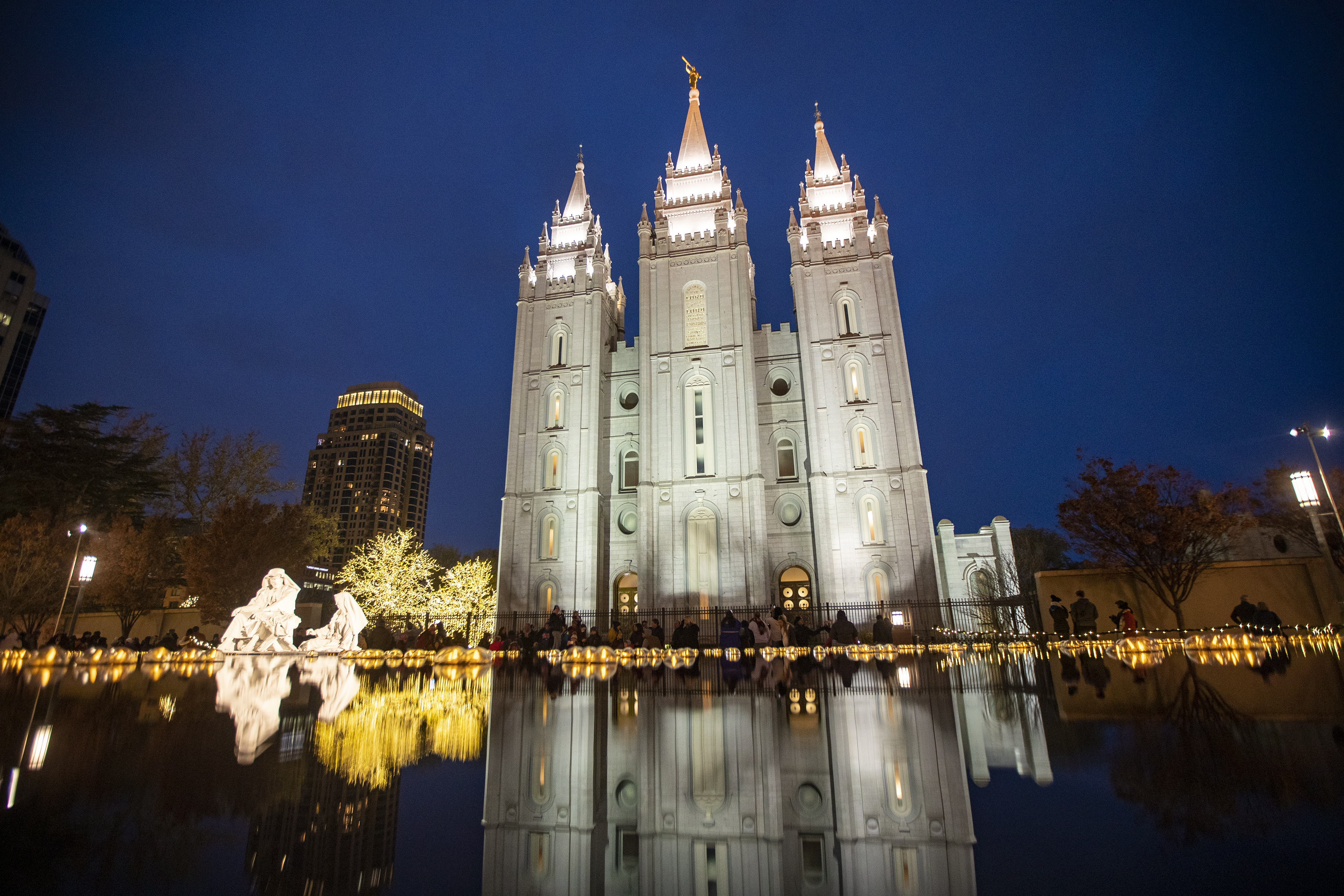 Thousands take in the colors as the lights are turned on at Temple Square in Salt Lake City on Friday, Nov. 23, 2018. In past Christmases, Church leaders have shared some of their favorite Christmas memories that help bring in the spirit of the season.