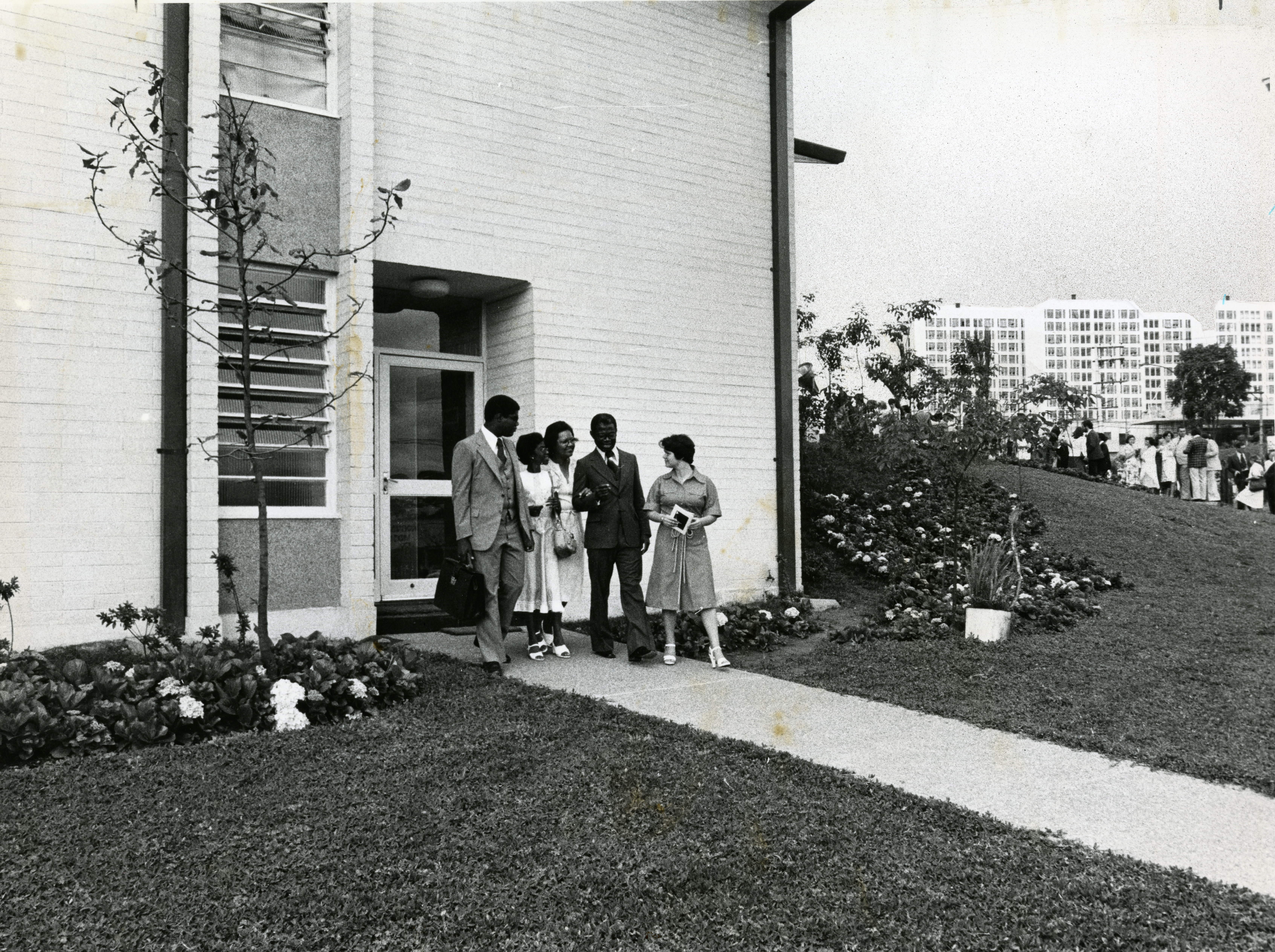 Elder Marcus Martins, left, one of the first blacks to serve as a full-time missionary, leaves a chapel with family members and a former missionary. Photo originally ran in the Nob. 11, 1978, Deseret News.