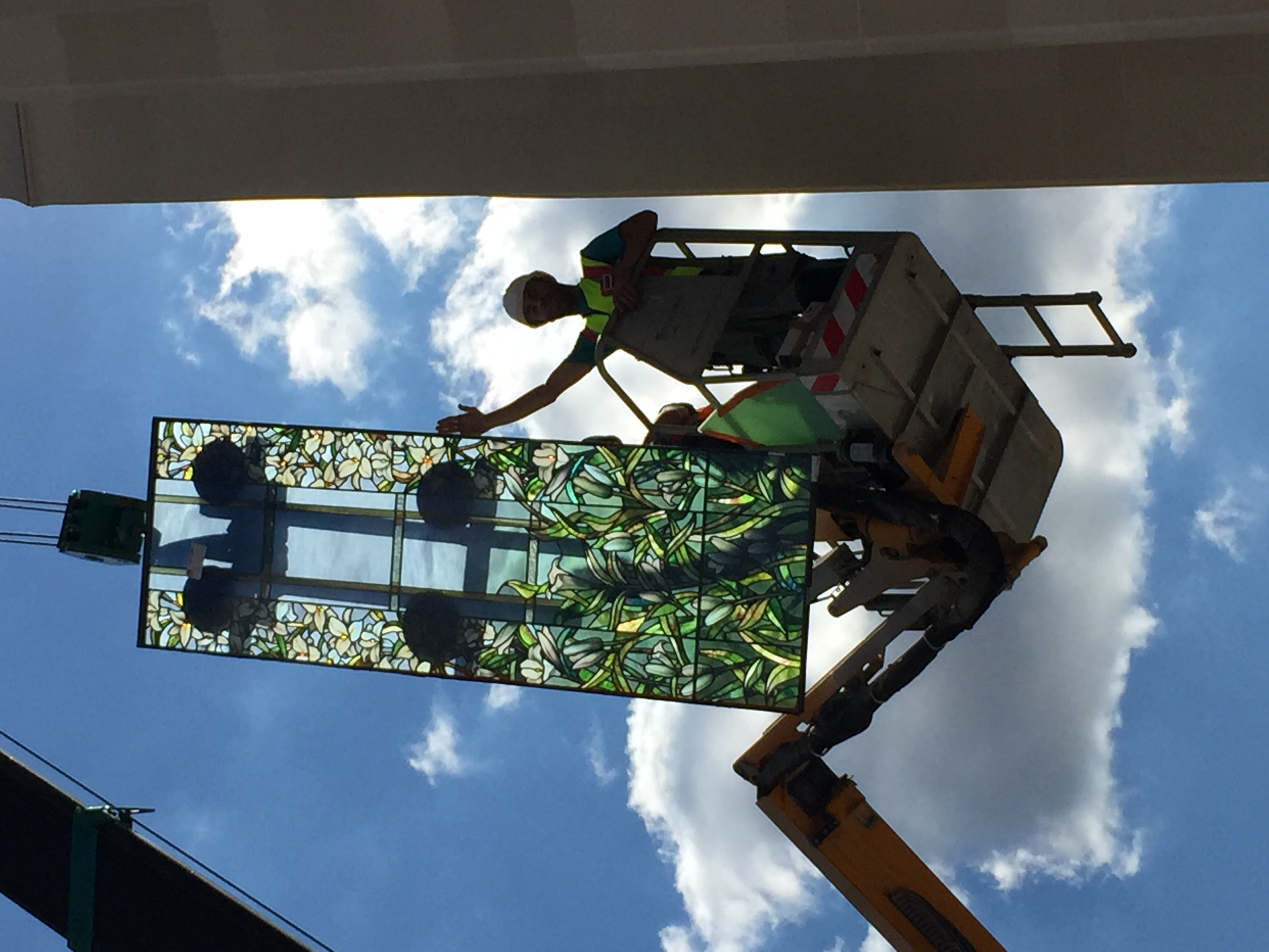 Workmen raise the madonna lily windows to install on the Paris France Temple.