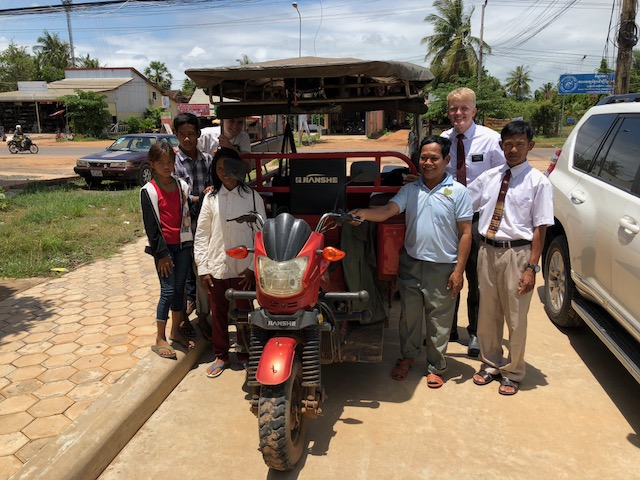 Missionaries with Keom Chhoeun Hul from Kampong Thom who uses his Tuk Tuk every Sunday to pick up members who live far from the Church building to get them to the Church for services.