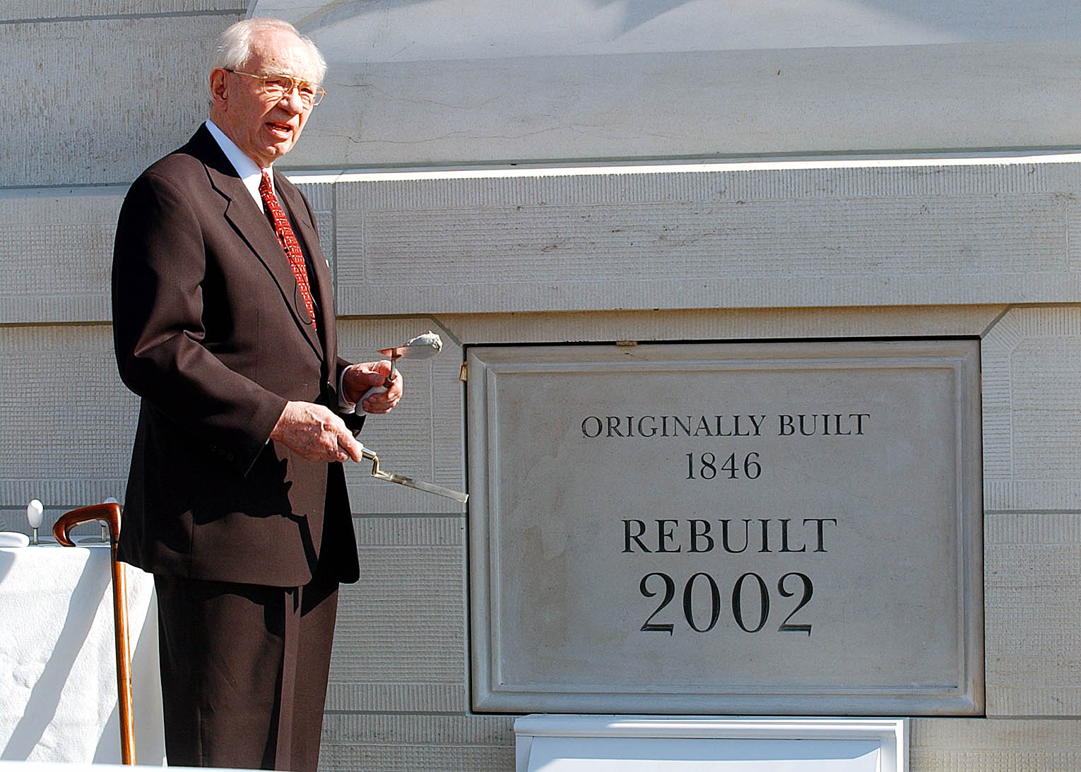 President Gordon B. Hinckley talks prior to applying mortar to the coverstone at the Nauvoo Illinois Temple June 27, 2002.