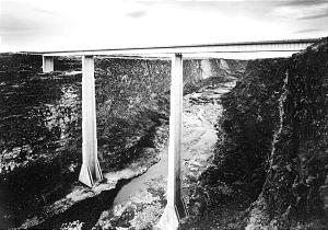 """Craig Law's 1989 photo """"Bridge Over the Snake River, near Hansen, Idaho"""" illustrates the impact of man-made structures on the American West."""