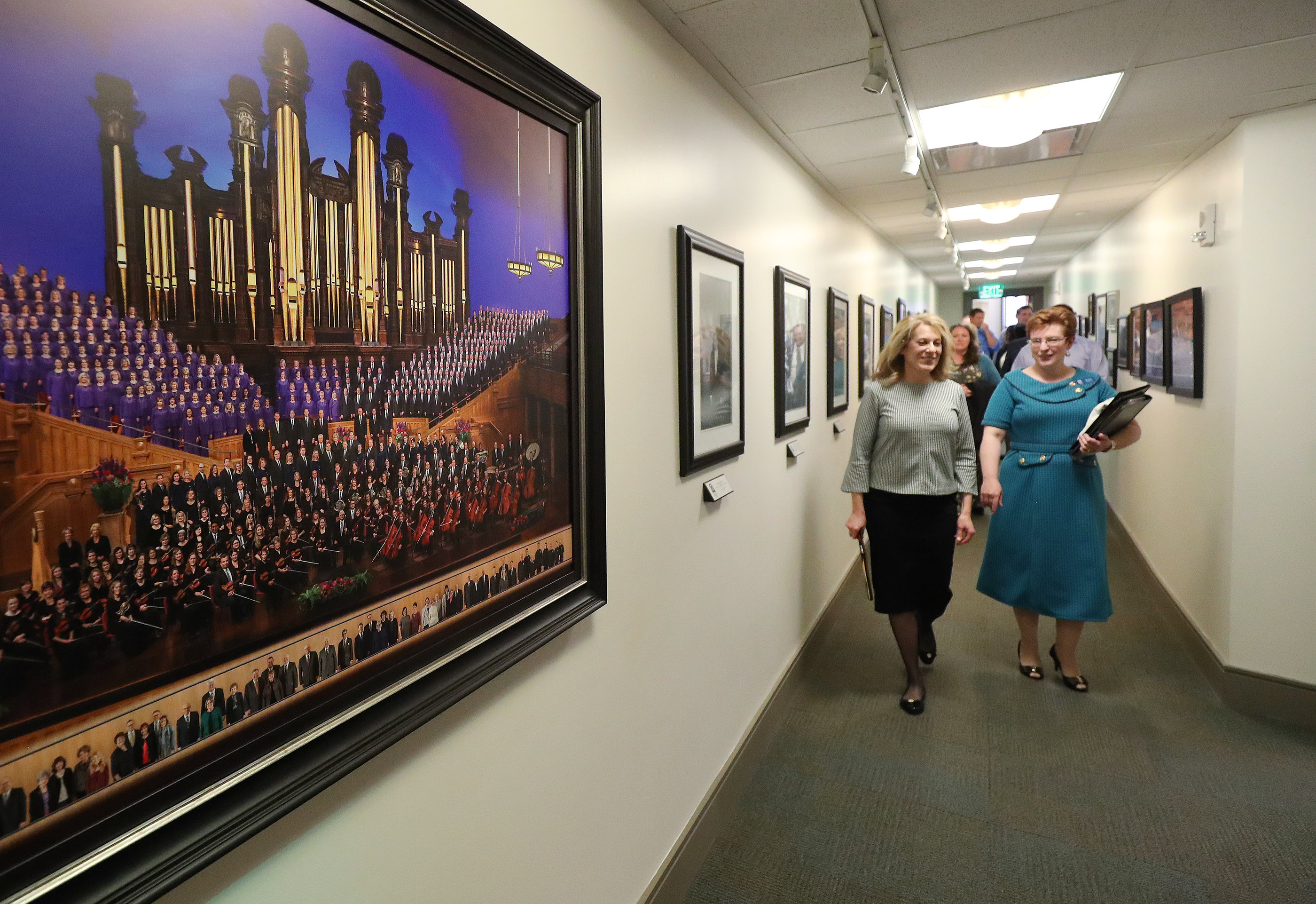 Debbie Matheson, left, is escorted by choir member Lori Hayward in preparation to sing with The Tabernacle Choir at Temple Square during a rehearsal in Salt Lake City on Thursday, April 11, 2019. Four people were selected through social media to sing with the choir.