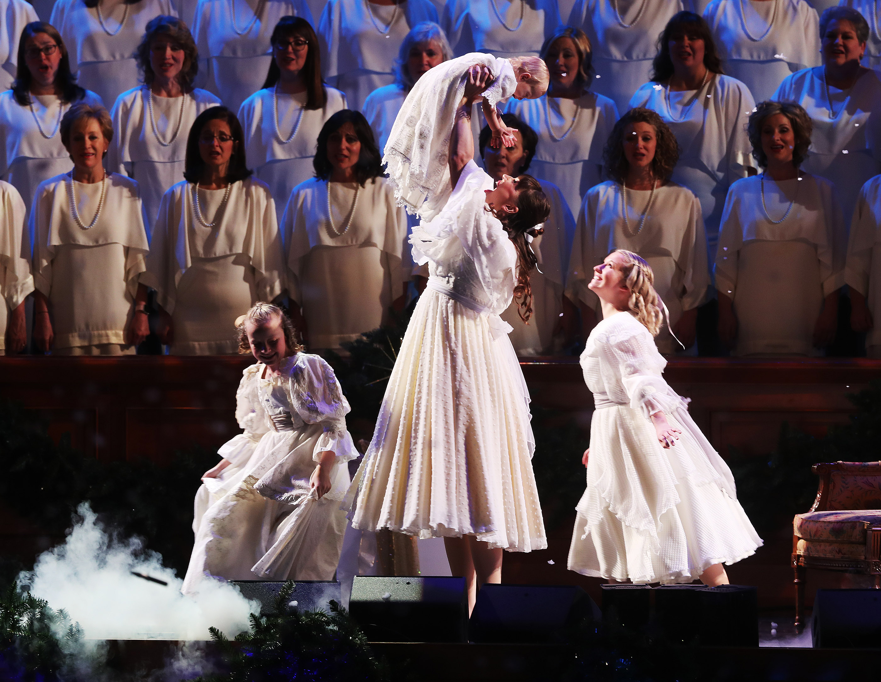 Performers accompany the Tabernacle Choir at Temple Square during their opening Christmas concert at the Conference Center at the Conference Center in Salt Lake City on Thursday, Dec. 13, 2018.