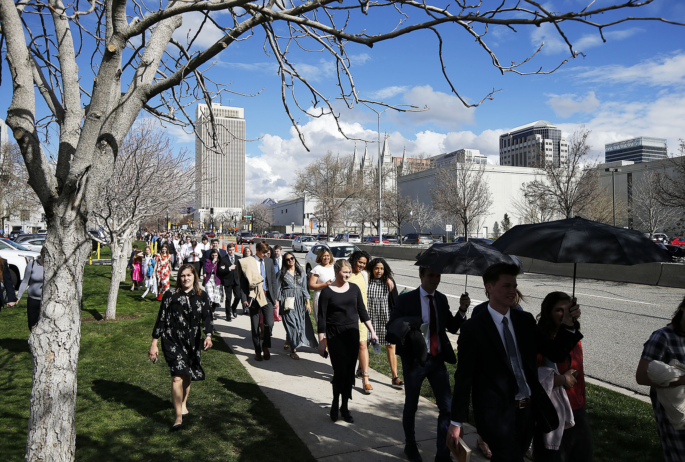 Conferencegoers walk from the Conference Center following the afternoon session of general conference of The Church of Jesus Christ of Latter-day Saints in Salt Lake City on Saturday, April 6, 2019.
