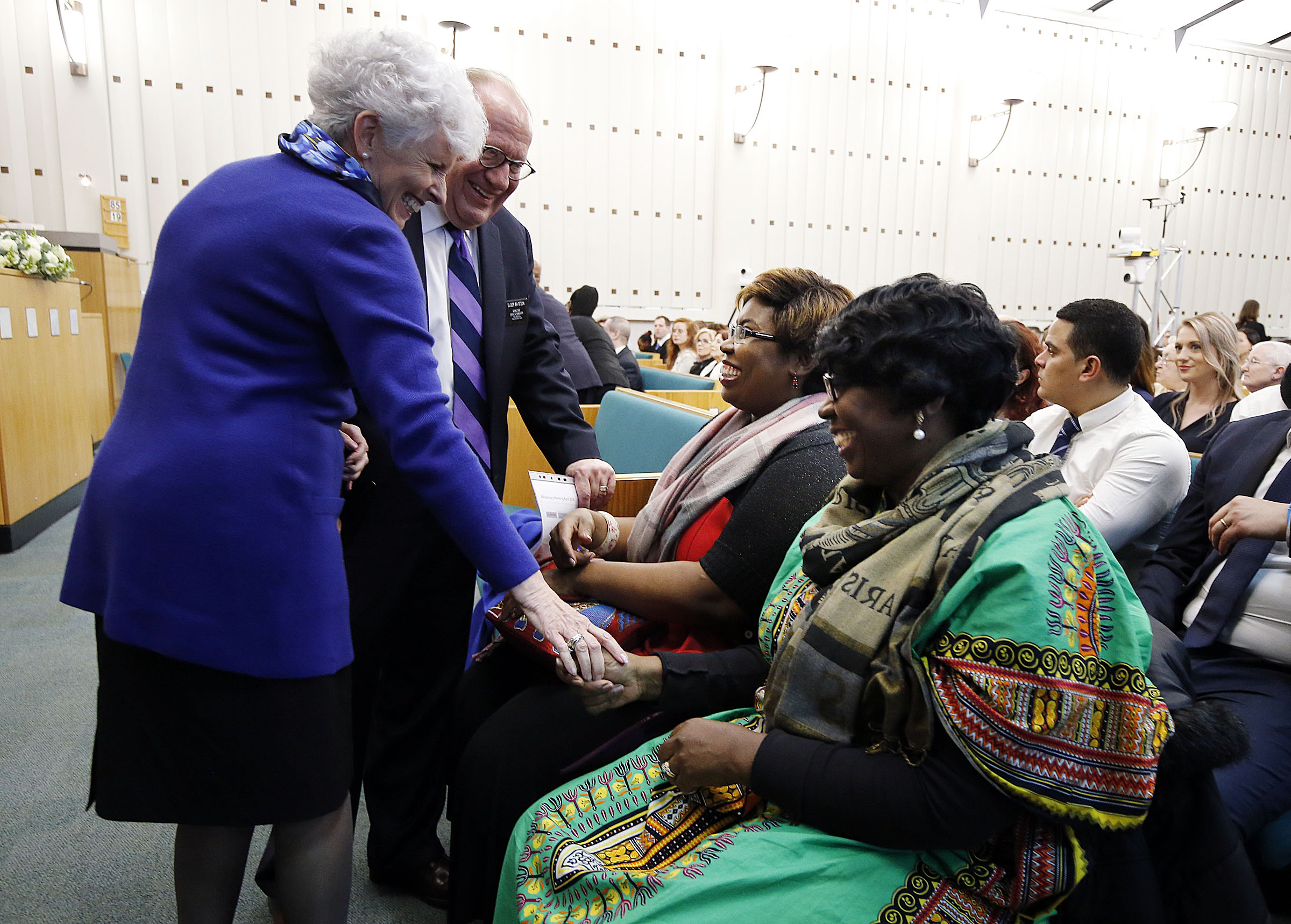 Sister Mona Bateson and Elder Jeff Bateson, left, greet Tina Cooke and Sonia Cooke before a meeting at the Hyde Park Chapel in London on Thursday, April 12, 2018.