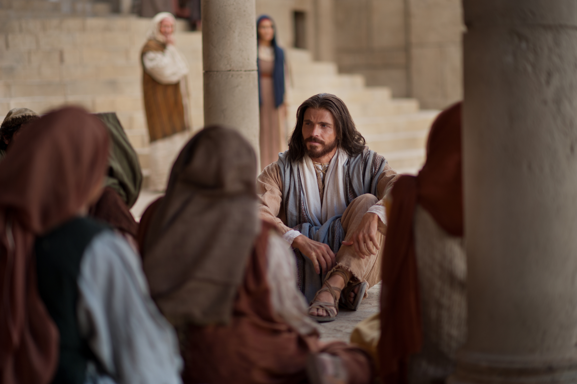 Christ teaches a group of people in an image from the Church's Bible videos.