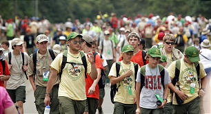 Boy Scouts, with their gear and plenty of water, walk to various activities sponsored during the National Scout Jamboree in Fort A.P. Hill, Virginia. The Jamboree is a time for memories and making commitments.