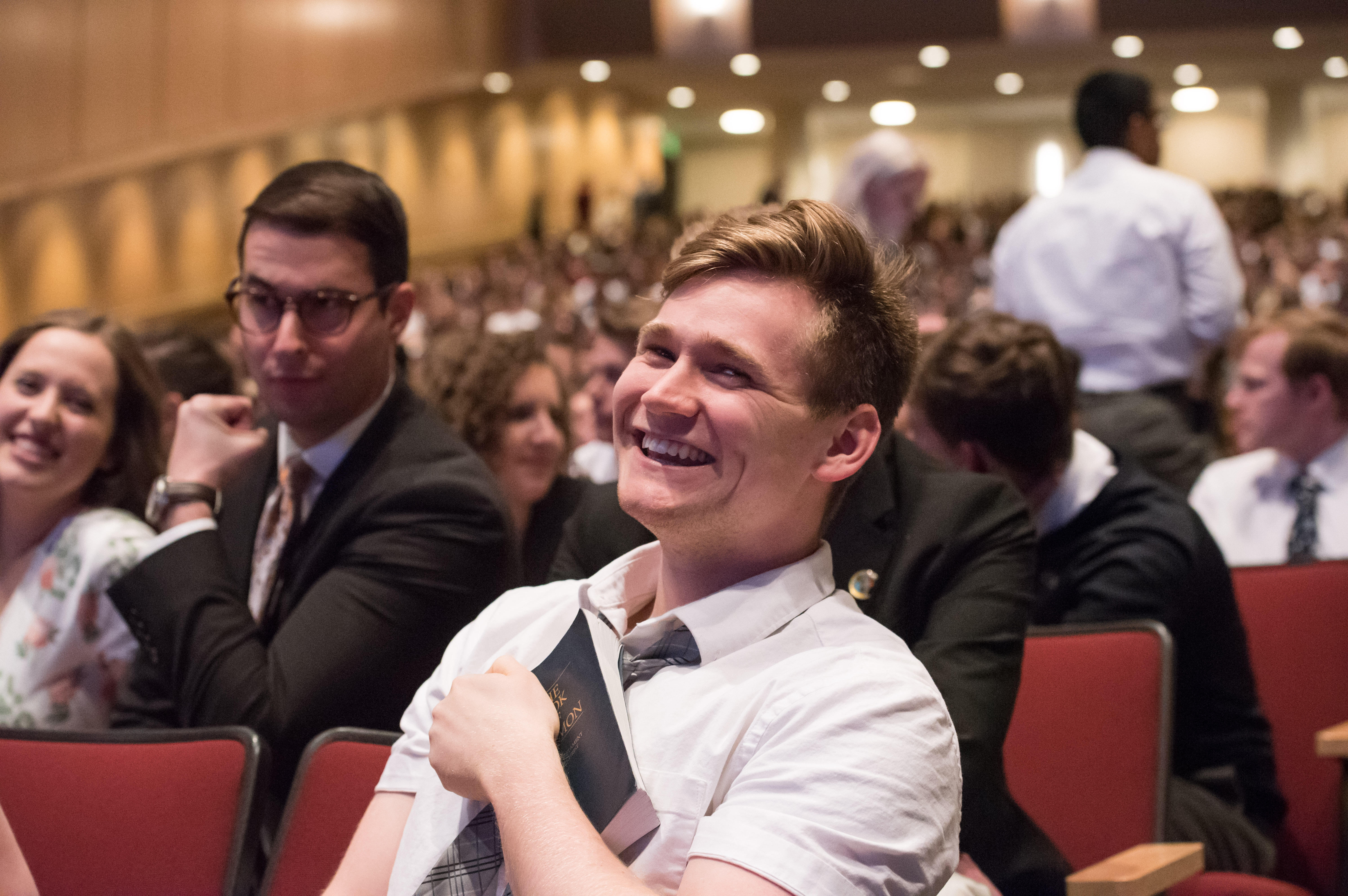 Students in the BYU-Idaho Center wait to hear Elder Ronald A. Rasband and his wife, Sister Melanie Rasband, speak during a devotional on April 28, 2019.