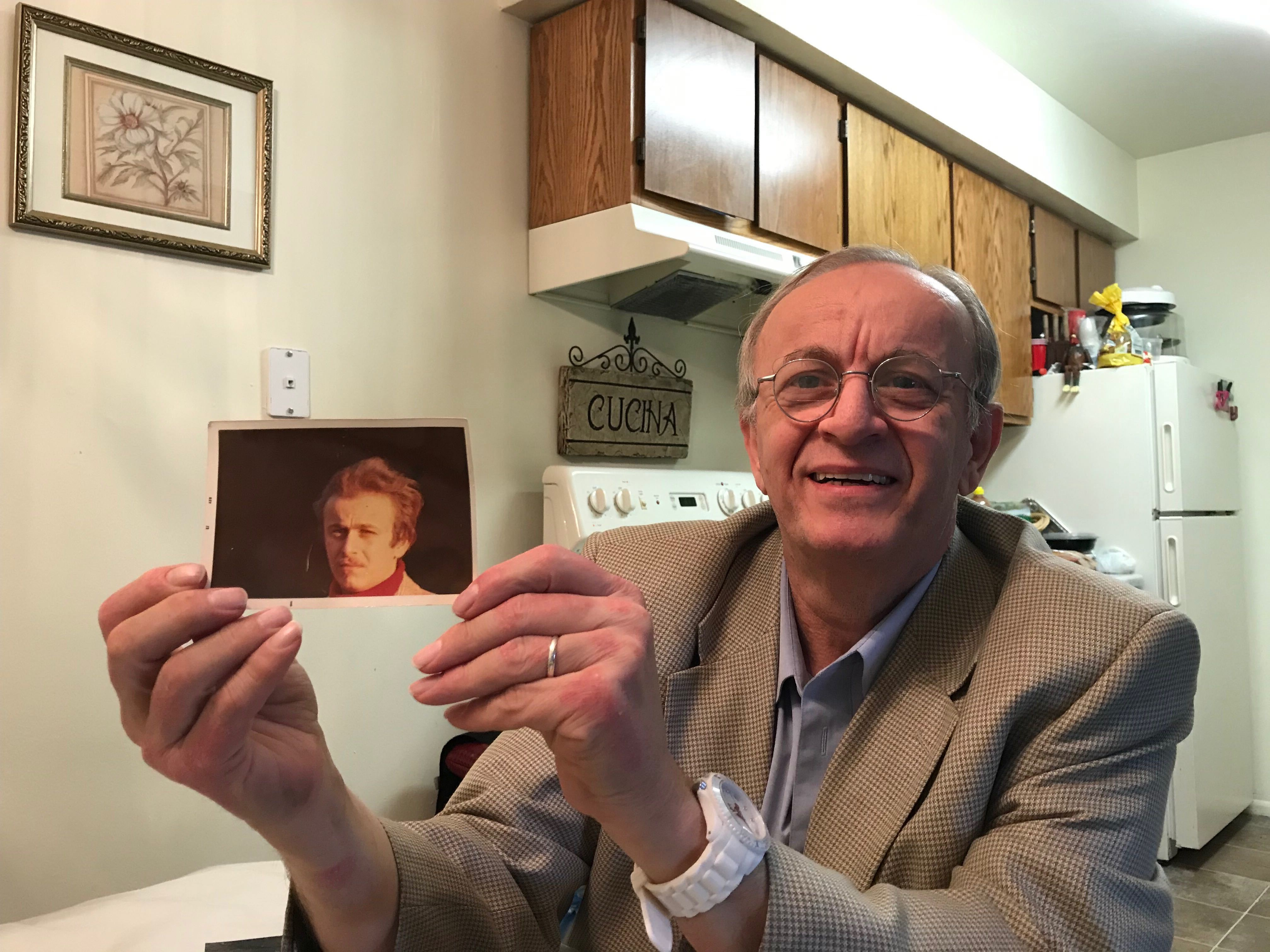 Roberto Deni holds up a photo of himself as a young man in his apartment in Murray. About 40 years ago, Deni served as a branch president of a small branch in Rome, Italy.