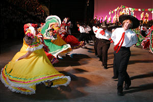 Youth perform dance as part of cultural celebration recognizing the Mexican heritage of northern California. Many of the show's dances were tributes to the ethnic and cultural diversity of the Sacramento California Temple district.