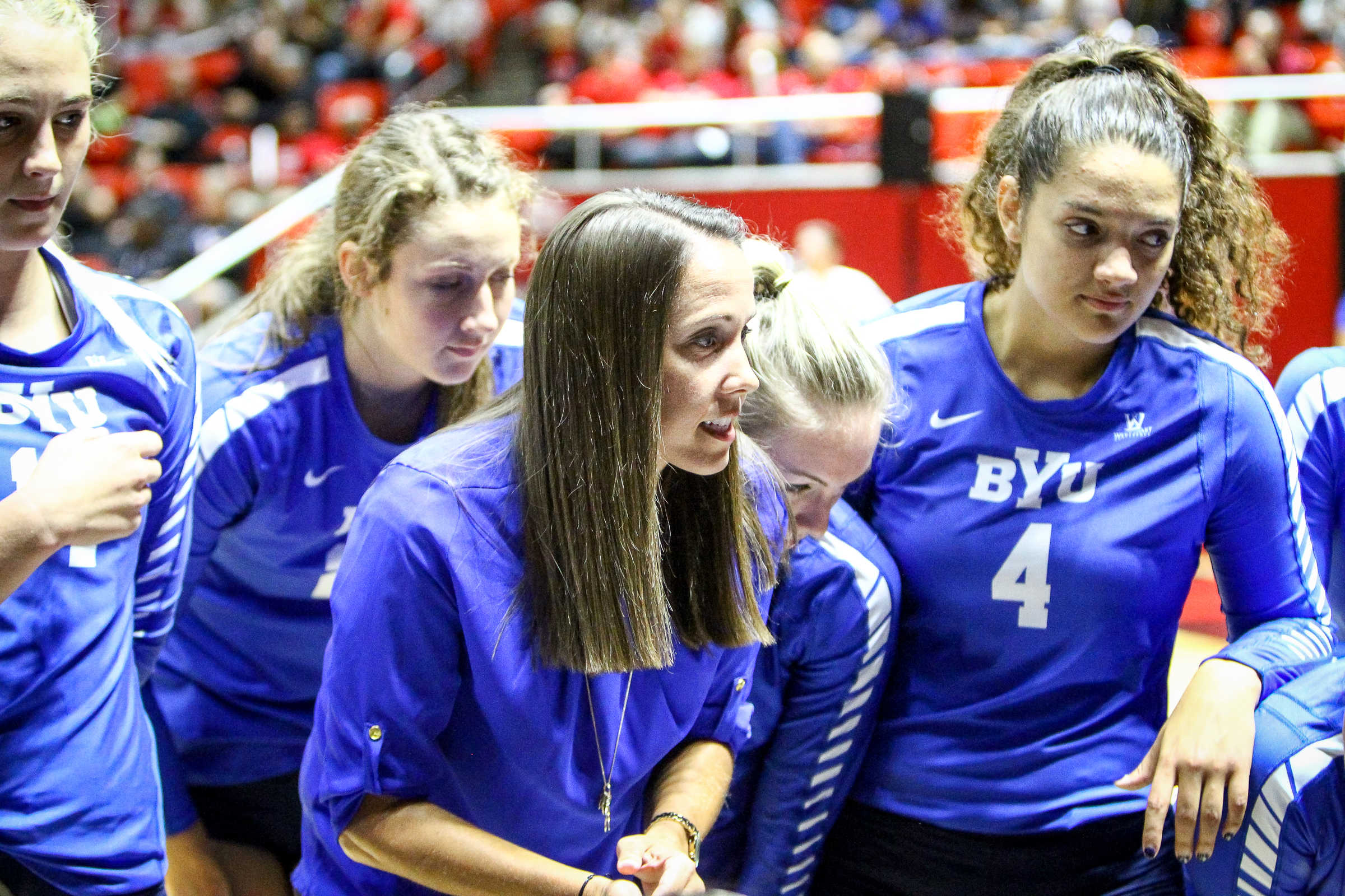 Brigham Young head volleyball coach Heather Olmstead talks with her players during a timeout at the Hunstman Center in Salt Lake City on Sept. 14, 2017.