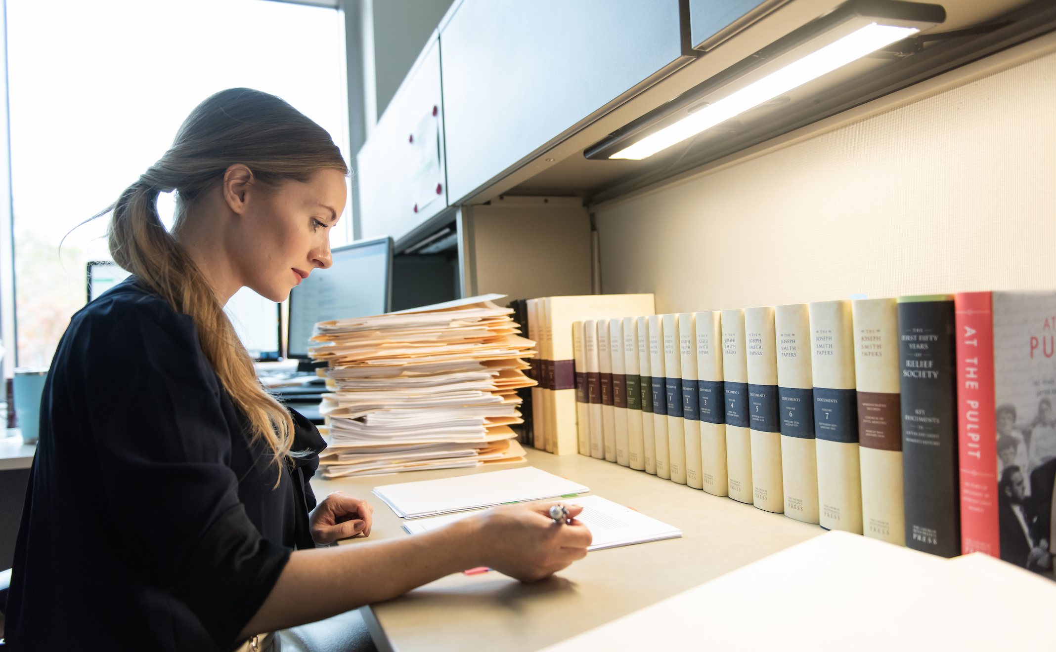 Shannon Kelly Jorgensen is a lead editor for the Joseph Smith Papers. She was photographed in her office while working on a forthcoming volume of the Joseph Smith Papers.