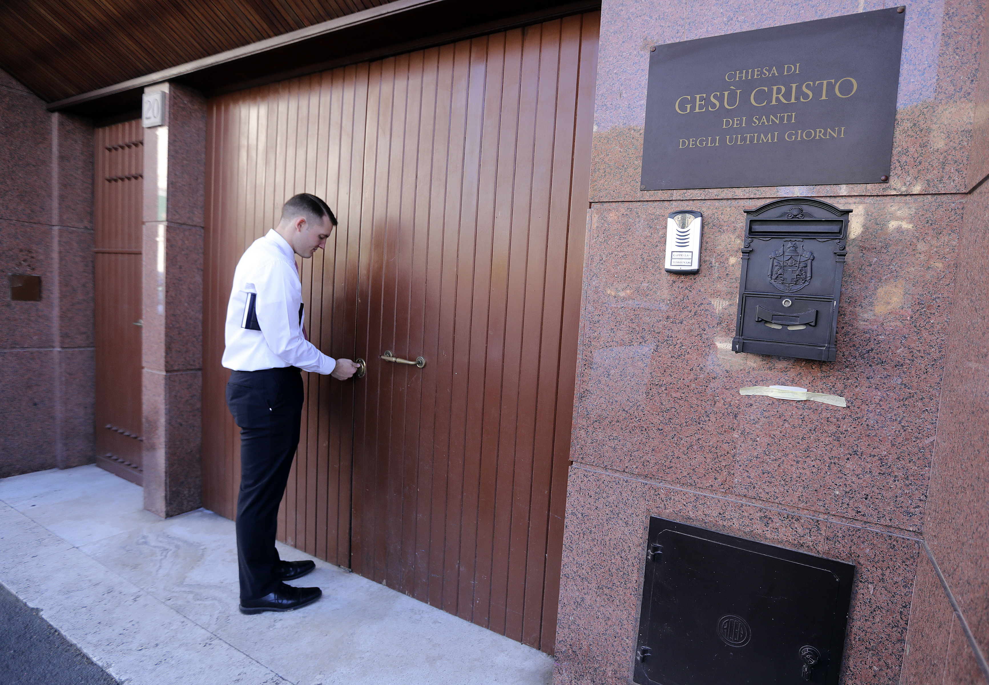 Elder Bryce Dickey unlocks the door to the Rome 2nd/5th wards meetinghouse in Rome, Italy, on Saturday, Nov. 17, 2018.