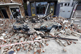 A car lies under the rubble of a building damaged in the Feb. 22 earthquake in Lyttleton, New Zealand.