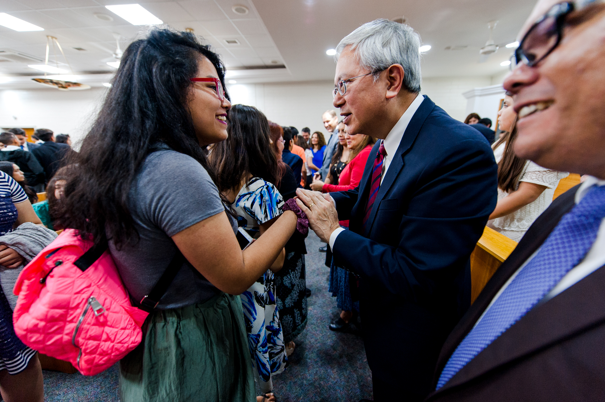 Elder Gong greets youth following a devotional in La Cisterna, Chile, on Nov. 9.