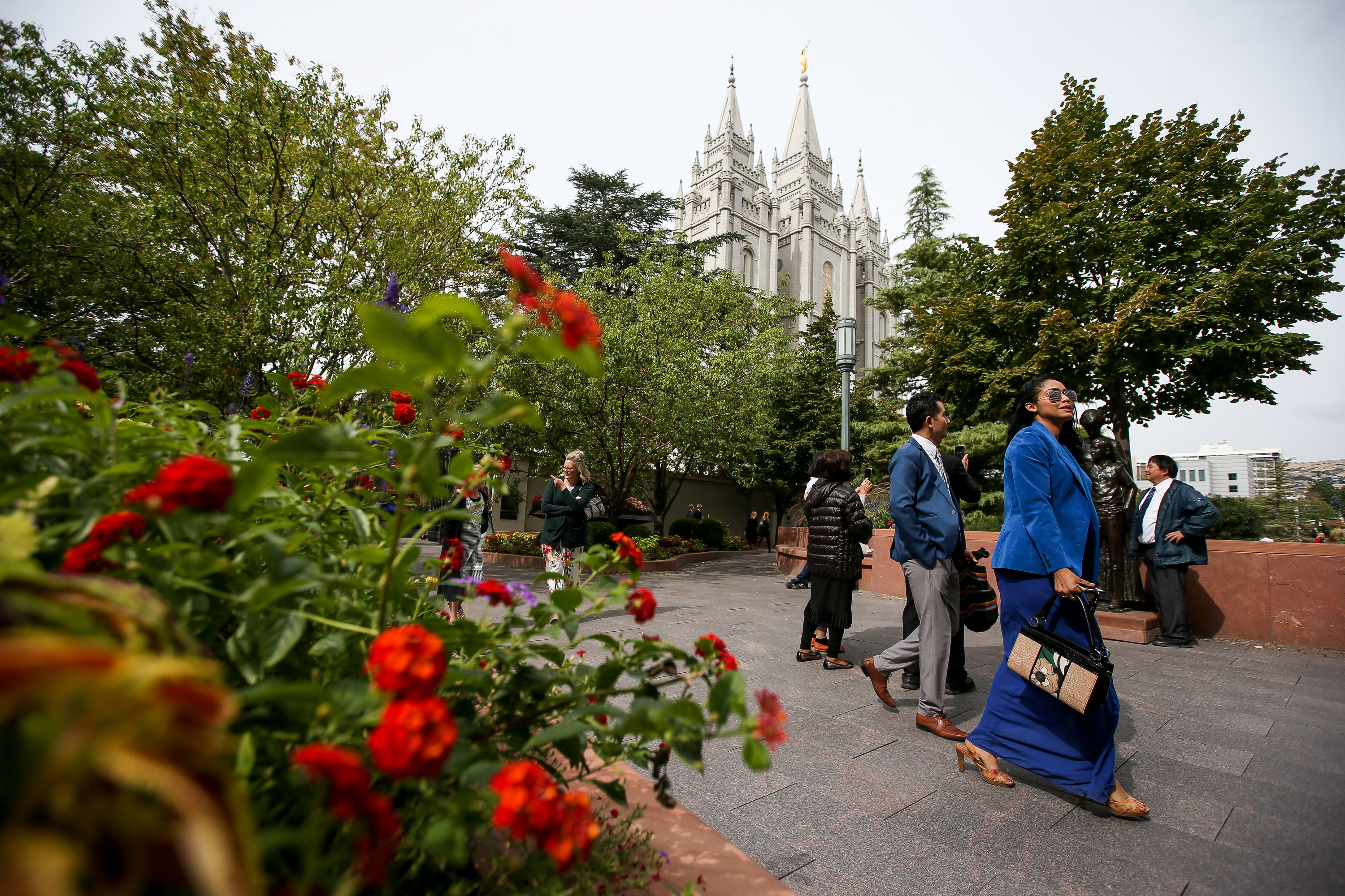 People walk outside of Temple Square after the Saturday morning session of the 188th Semiannual General Conference of The Church of Jesus Christ of Latter-day Saints in the Conference Center in Salt Lake City on Saturday, Oct. 6, 2018.