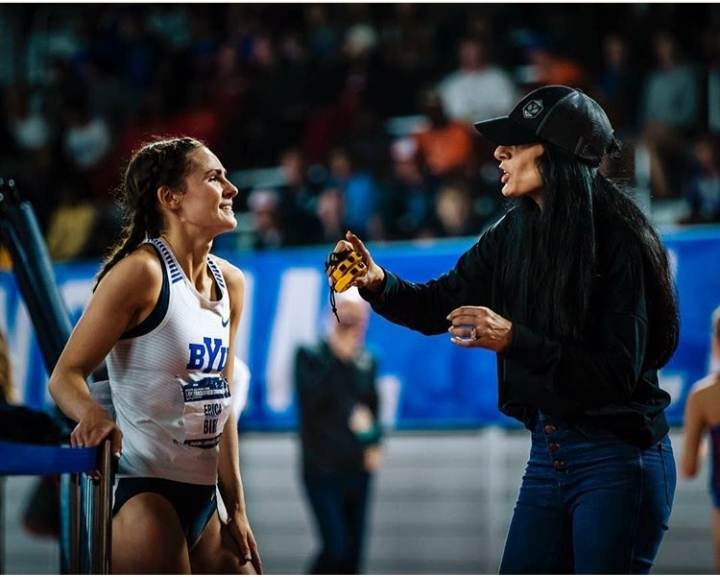 BYU athlete Erica Birk-Jarvis confers with her Coach Diljeet Taylor during a recent indoor track meet.