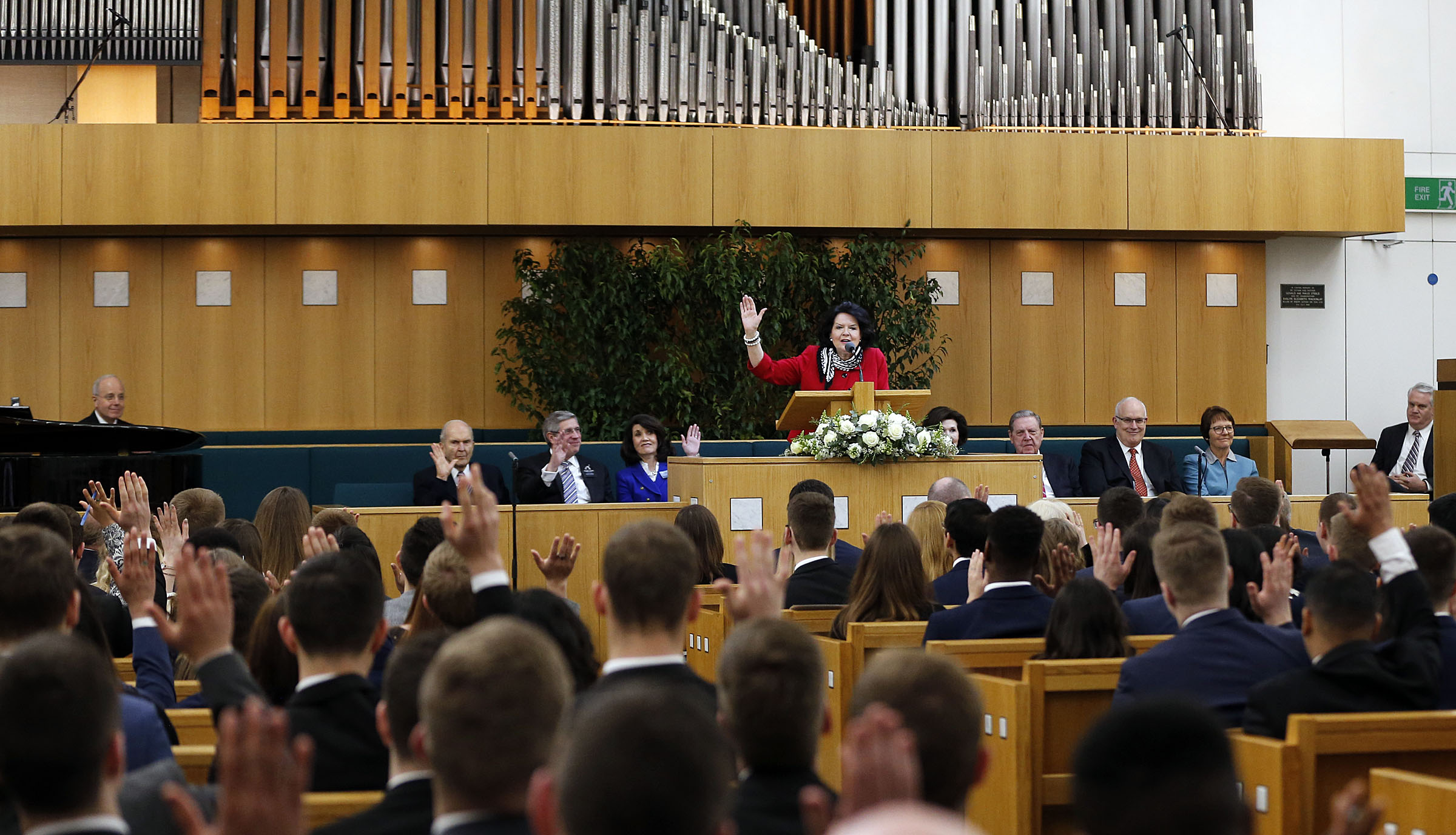 Sister Wendy Nelson asks a question of missionaries as she speaks at the Hyde Park Chapel in London on Thursday, April 12, 2018.