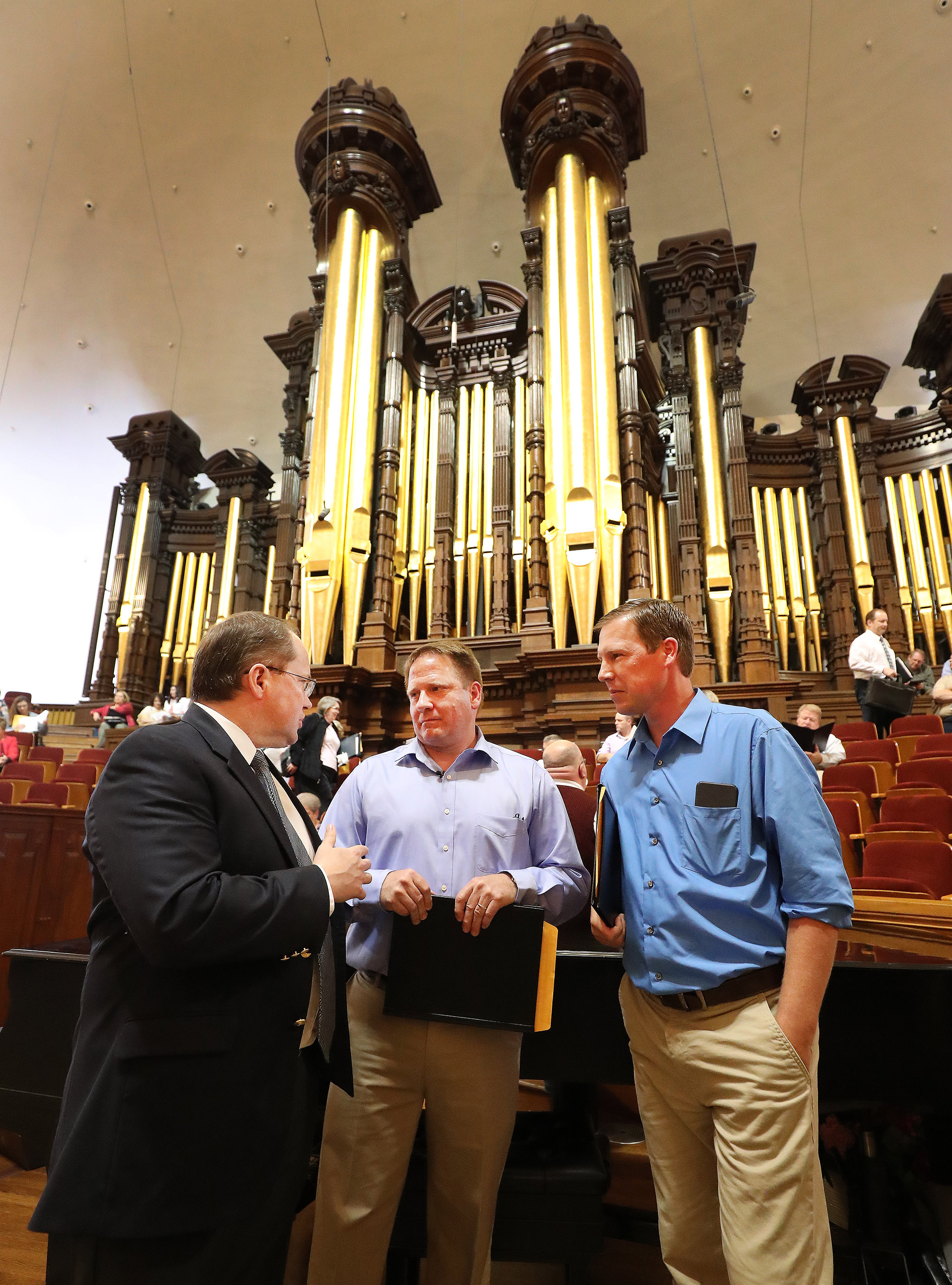 Choir member David Stevenson, left, talks with Daniel Wilson and Matt Breshears in preparation to sing with The Tabernacle Choir at Temple Square during a rehearsal in Salt Lake City on Thursday, April 11, 2019. Four people were selected through social media to sing with the choir.