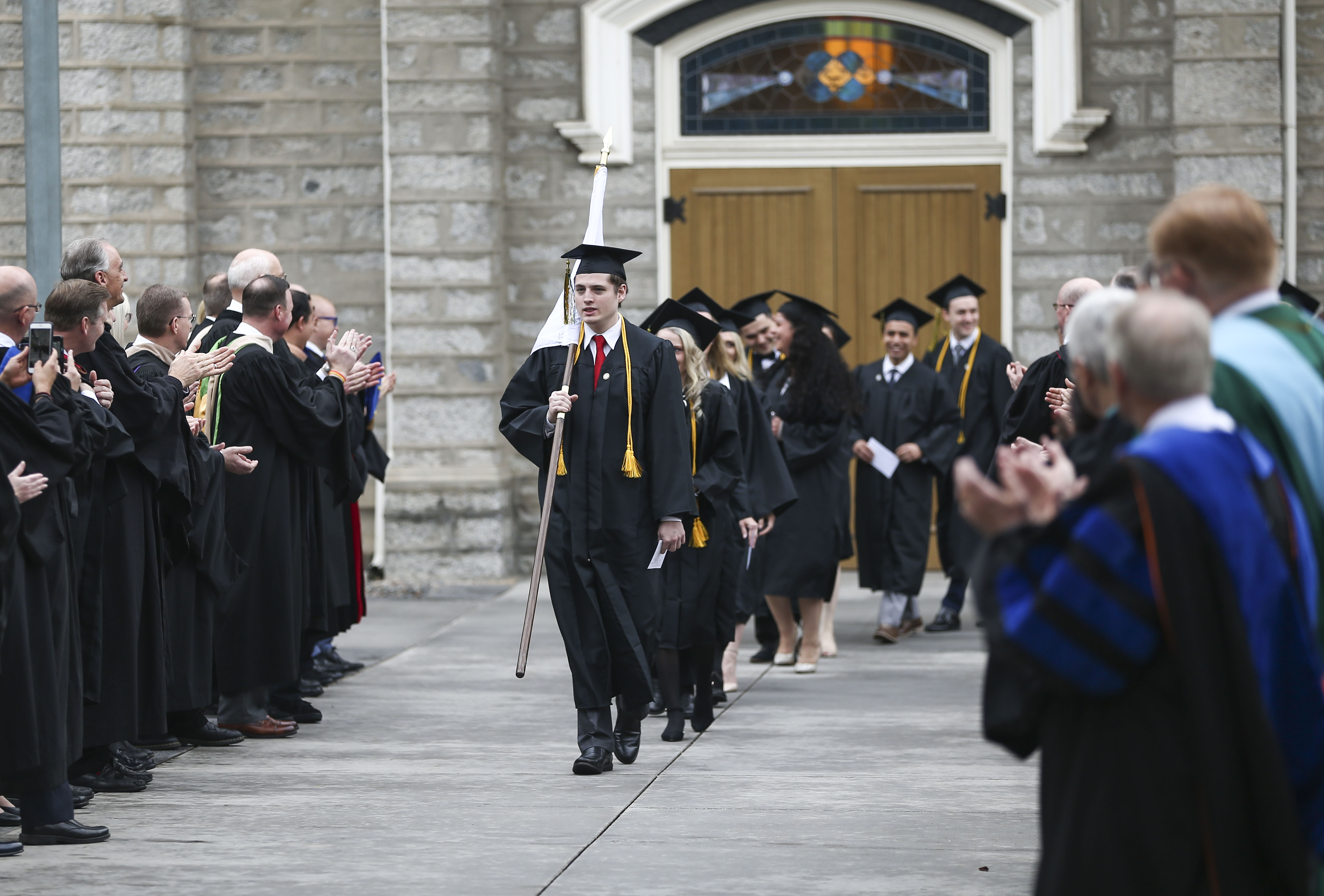 Students from the LDS business college walk to the Tabernacle on Temple Square for their commencement ceremony in Salt Lake City on Friday, April 12, 2019.