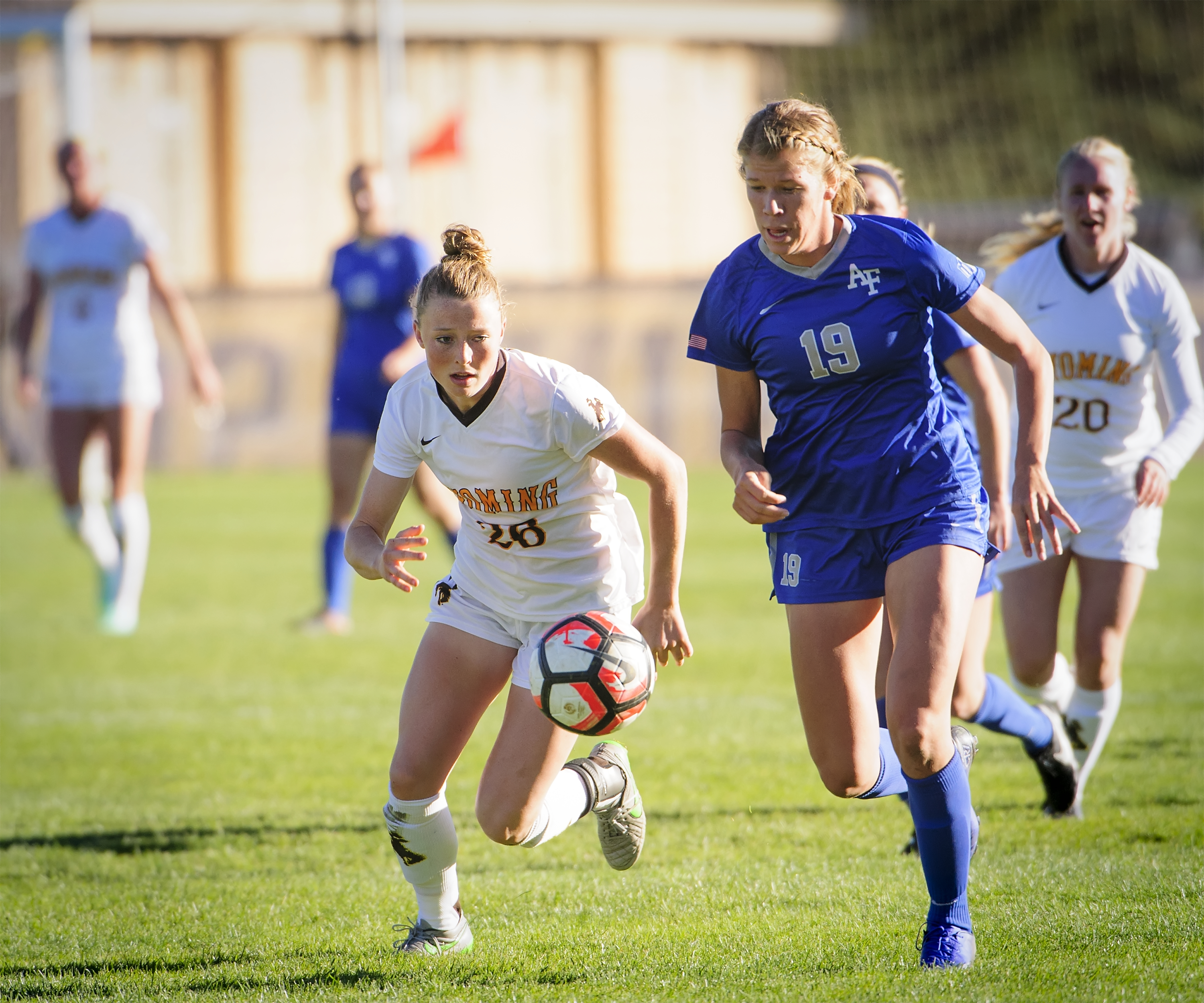Wyoming's Charlotte Hume, left, battles for a soccer ball against the United States Air Force Academy.