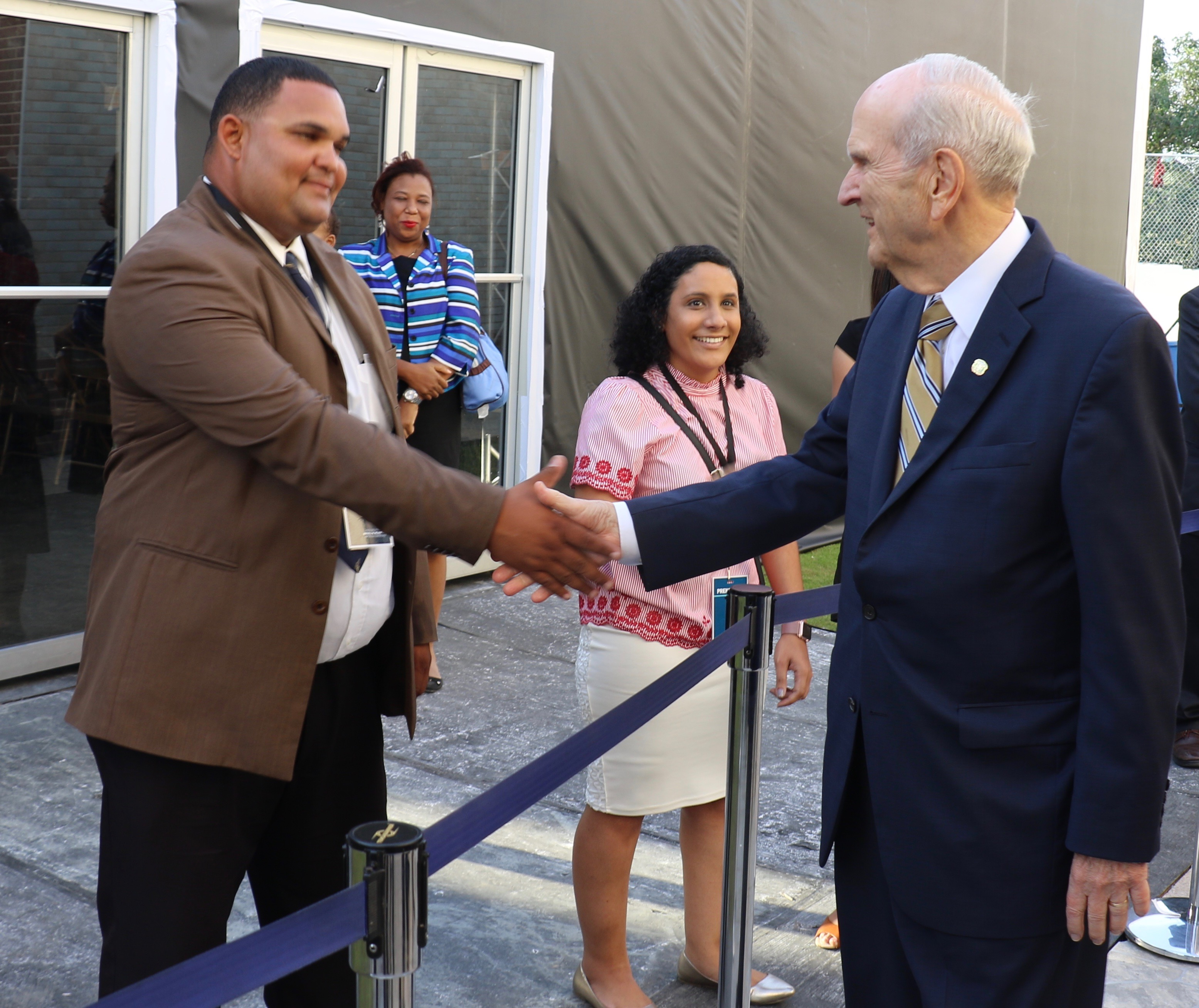 Dominican member Michel Acosta shakes hands with President Russell M. Nelson following a Sept. 1, 2018, member devotional in Santo Domingo, Dominican Republic.