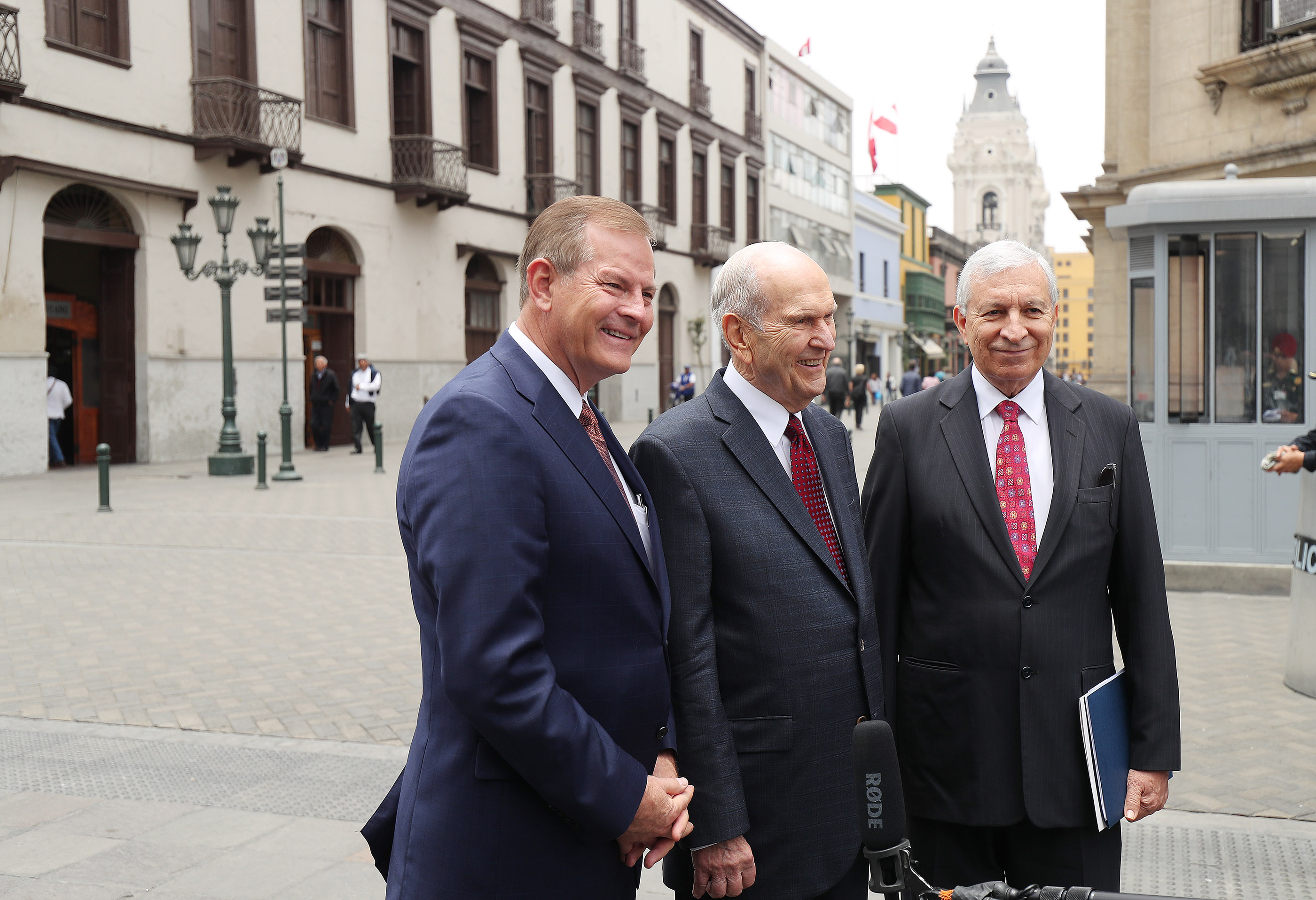 President Russell M. Nelson, center, Elder Gary E. Stevenson of the Quorum of the Twelve Apostles, left, and Elder Enrique Falabella, General Authority Seventy, right, speak with media after leaving the Government Palace after meeting with the president of Peru in Lima, Peru, on Oct. 20, 2018.