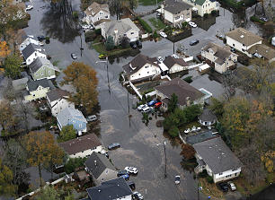 Floodwaters fill the streets of Little Ferry, N.J. in the wake of superstorm Sandy on Tuesday, Oct. 30, 2012. Sandy, the storm that made landfall Monday, caused multiple fatalities, halted mass transit and cut power to more than 6 million homes and businesses.