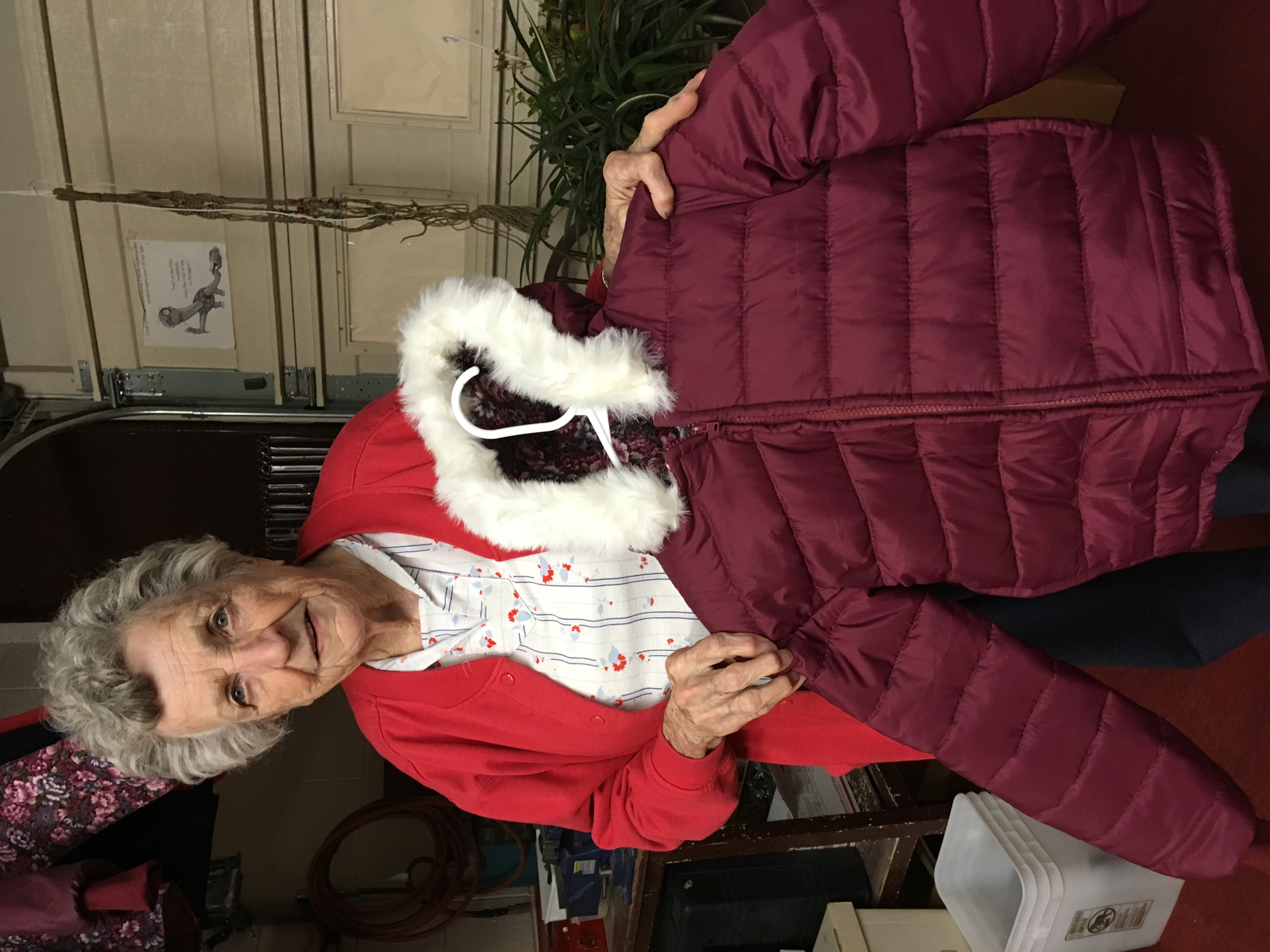 Betty Luke displays one of her hooded coats for Humanitarian Center.
