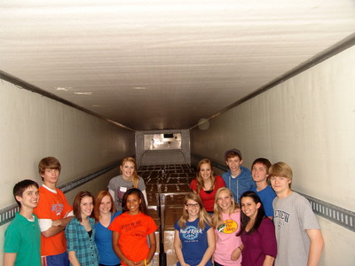 Youth respond to a call to assist in preparing materials at the Tucker, Ga., Bishops' Storehouse. They pause for a photo in a trailer prior to it being loaded and send to areas affected by recent severe weather.