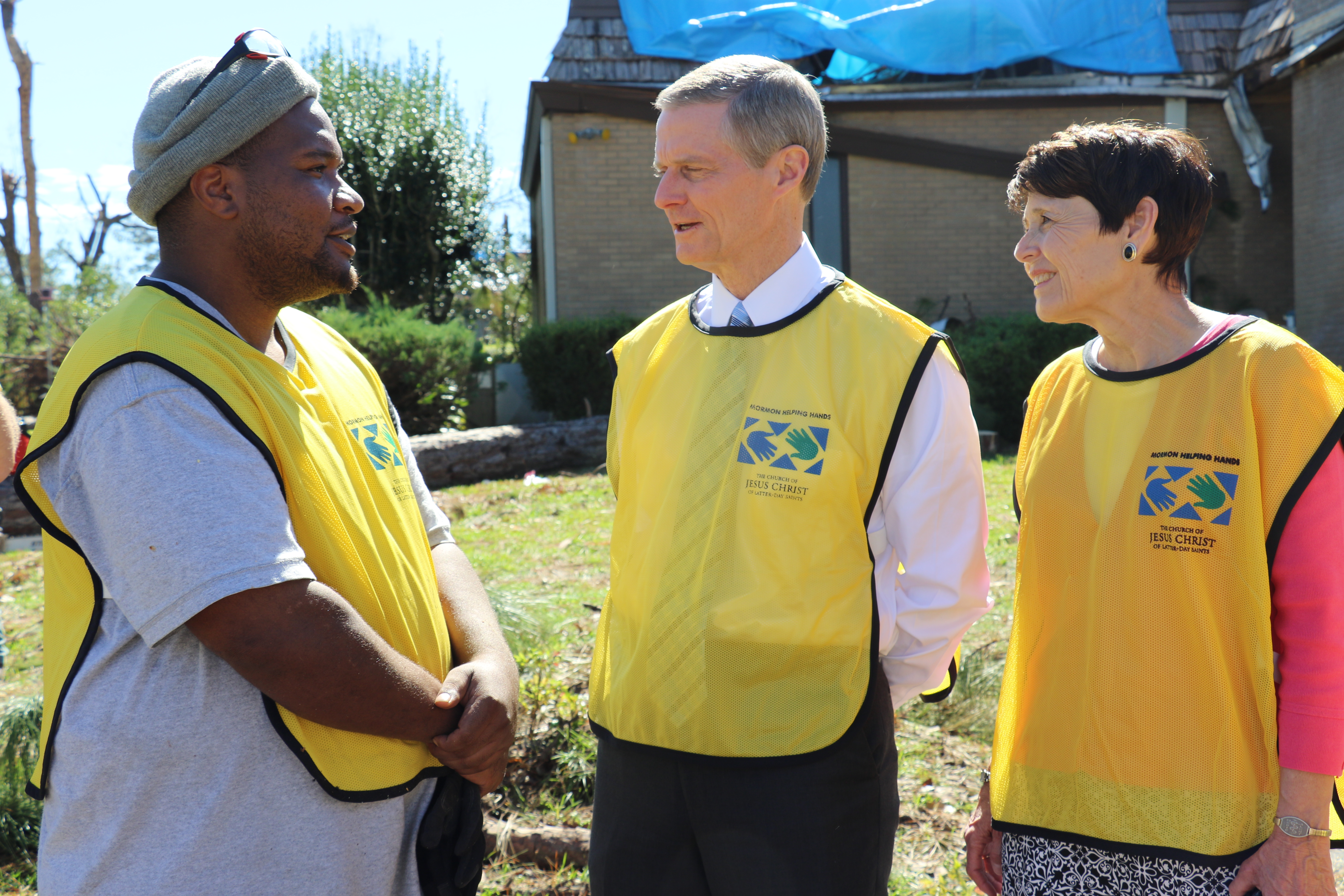 Elder David A. Bednar of The Church of Jesus Christ of Latter-day Saints' Quorum of the Twelve Apostles and his wife, Sister Susan Bednar, enjoy getting to know Dennis Kern, a recent Church convert and Helping Hands volunteer in Marianna, Florida.
