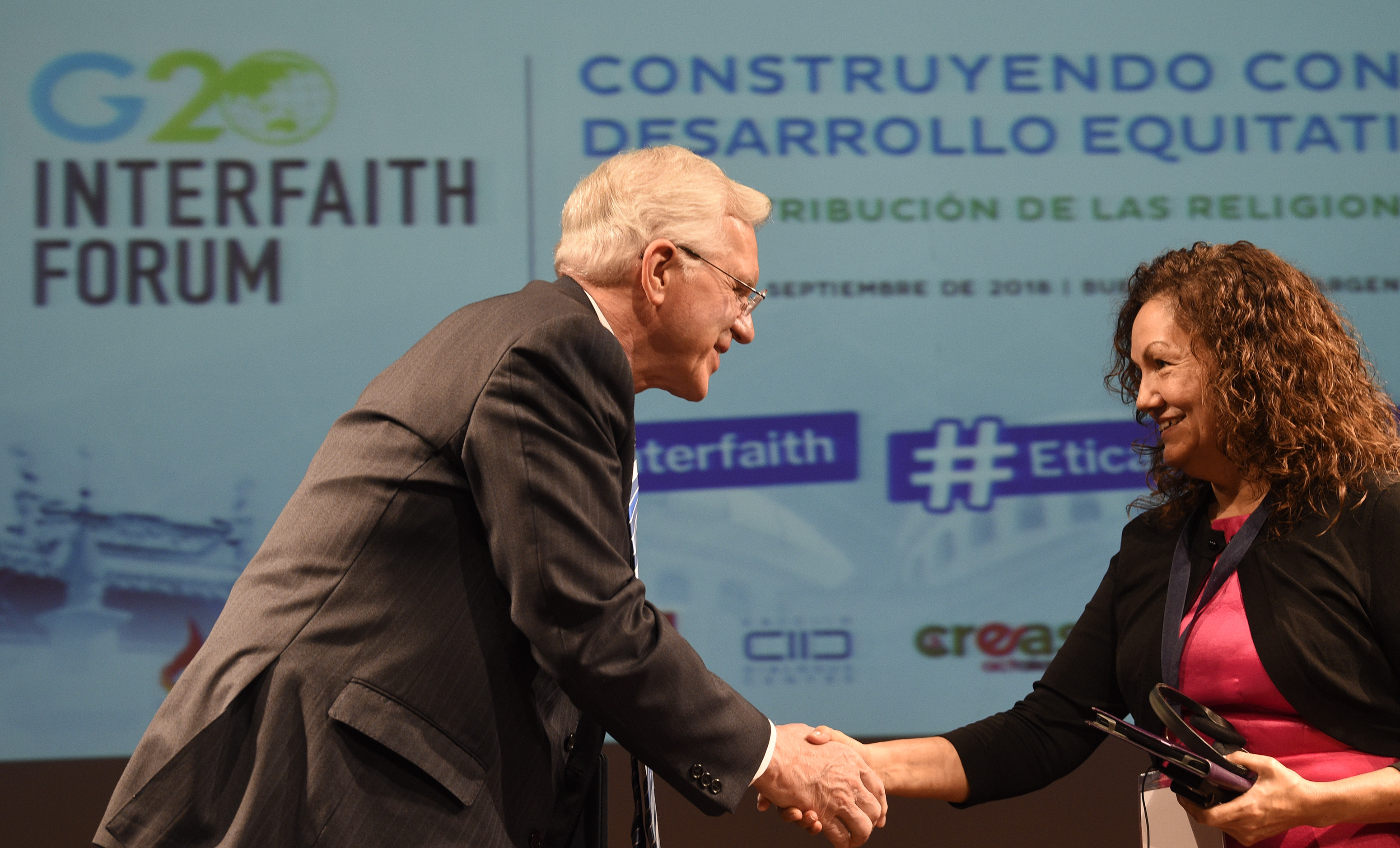 Elder D. Todd Christofferson, left, greets Rev. Gloria Ulloa from Colombia during the G20 Interfaith Forum in Buenos Aires, Argentina, on Wednesday, Sept. 26, 2018.